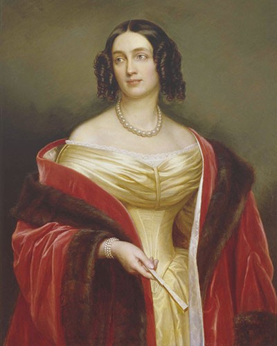 Elise painted in a gold dress with a red fur-trimmed cloak. Her brown hair is curled and gathered over her ears.