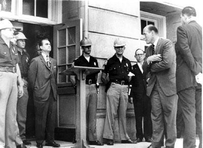 Governor George Wallace of Alabama is blocking the schoolhouse door at the University of Alabama to prevent integration. 1963