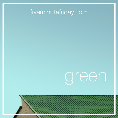 """A green roof against a blue sky background with the word """"green"""" in white letters."""