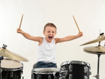 I started on the drums. Good grief, my parents were patient.