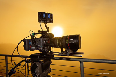 A video camera with a sunset in the background.