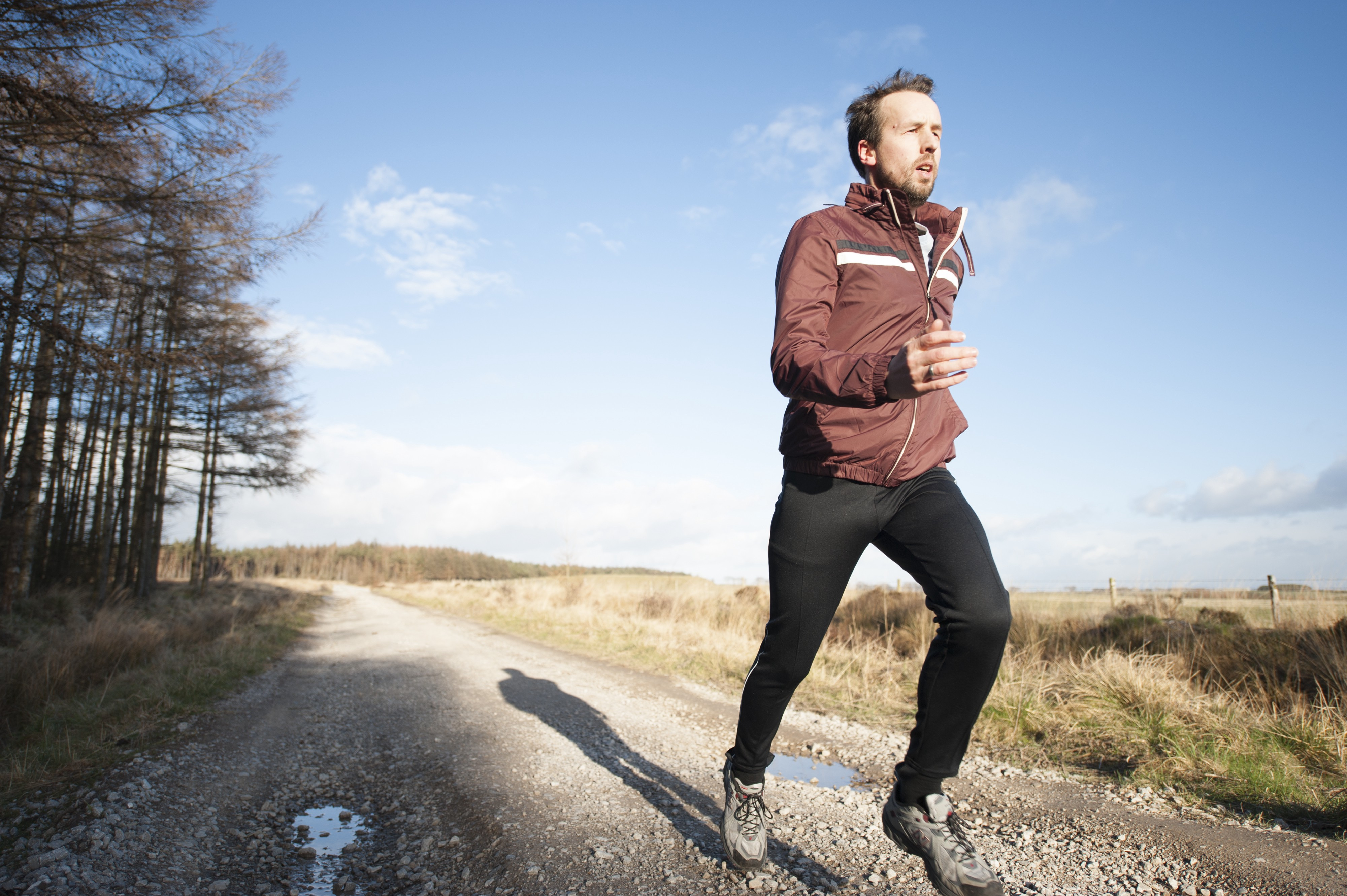 man jogging in the countryside for article by Larry G. Maguire