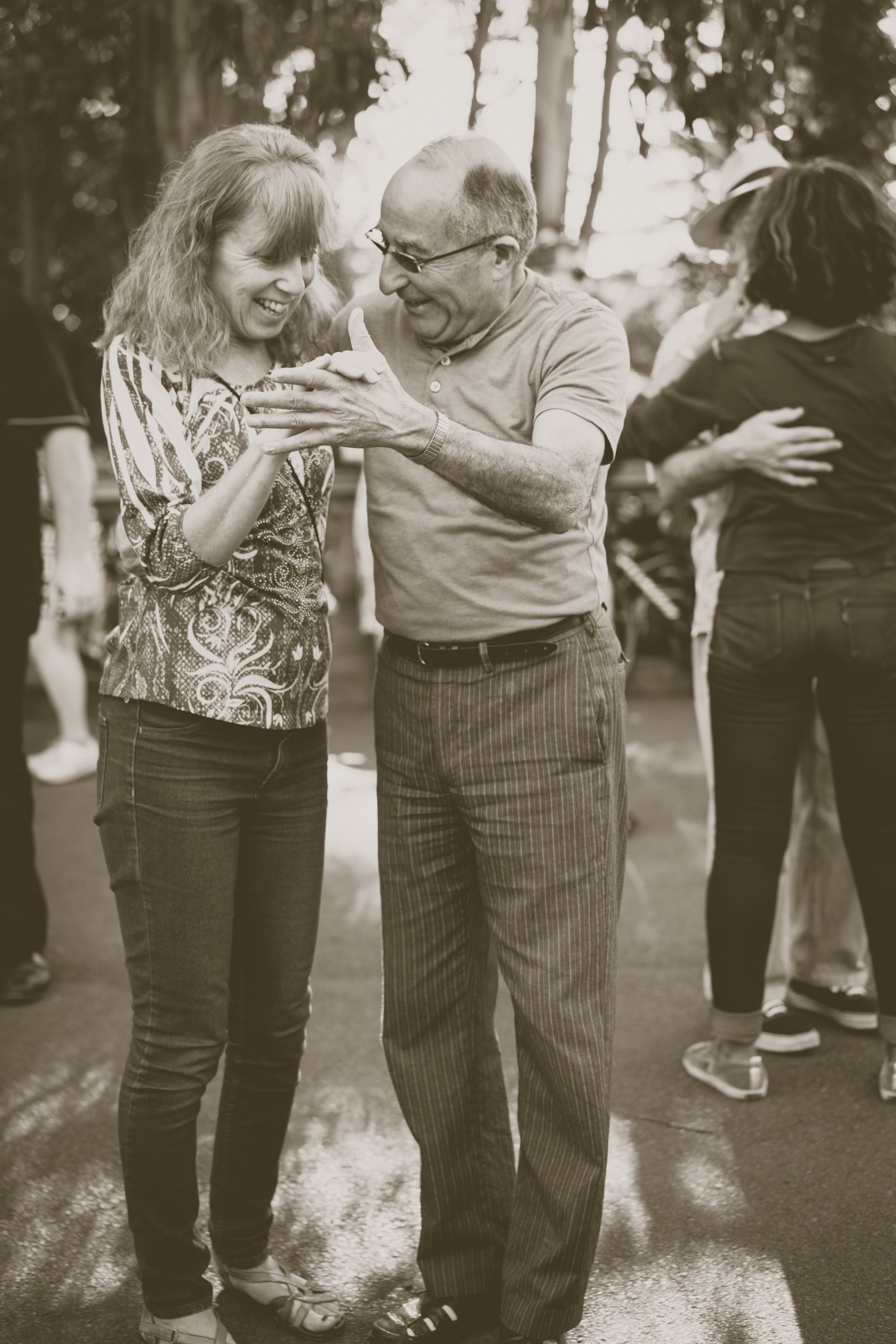 Old person dancing with middle aged person