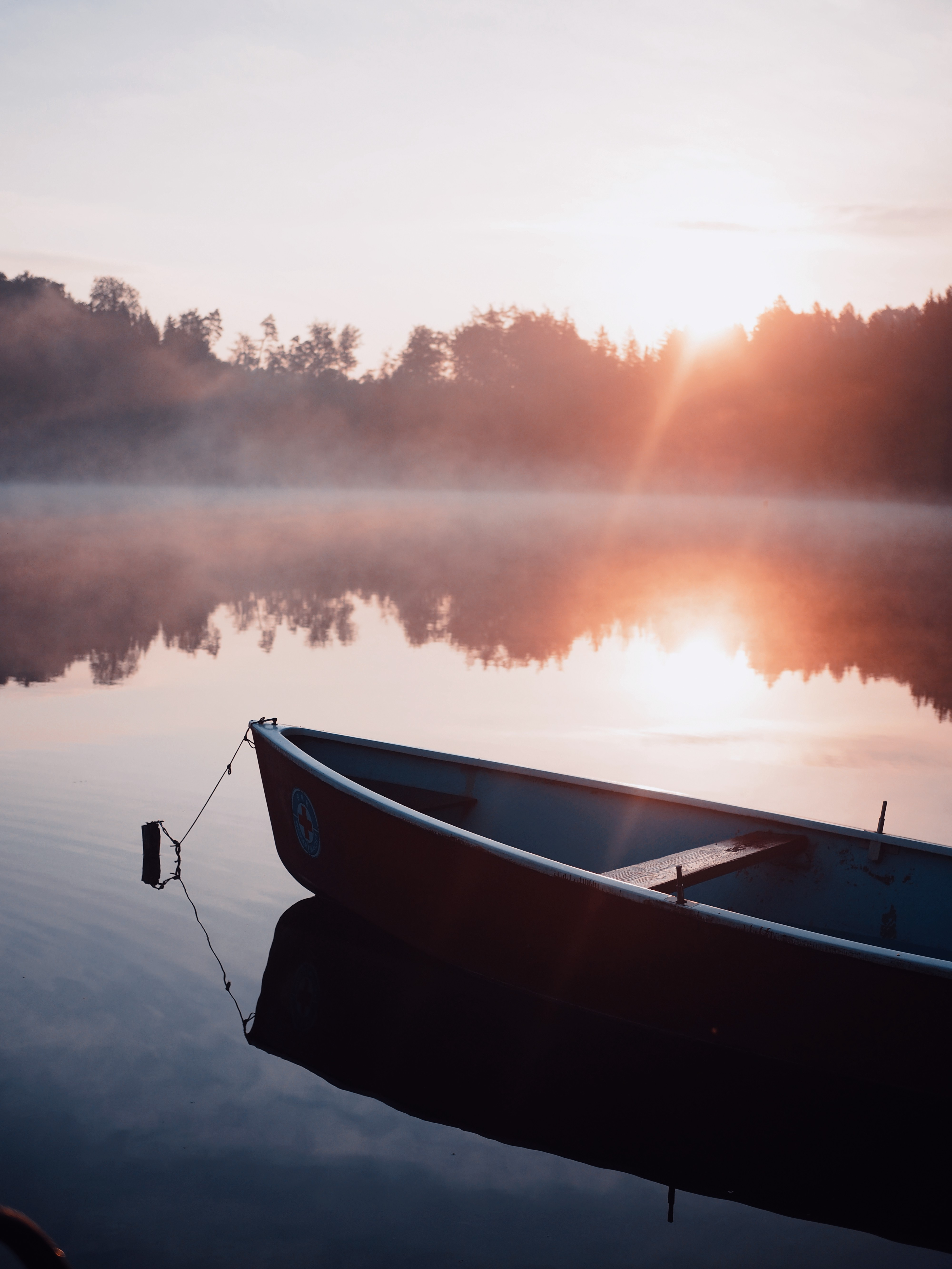 boat on the water during the sun rising