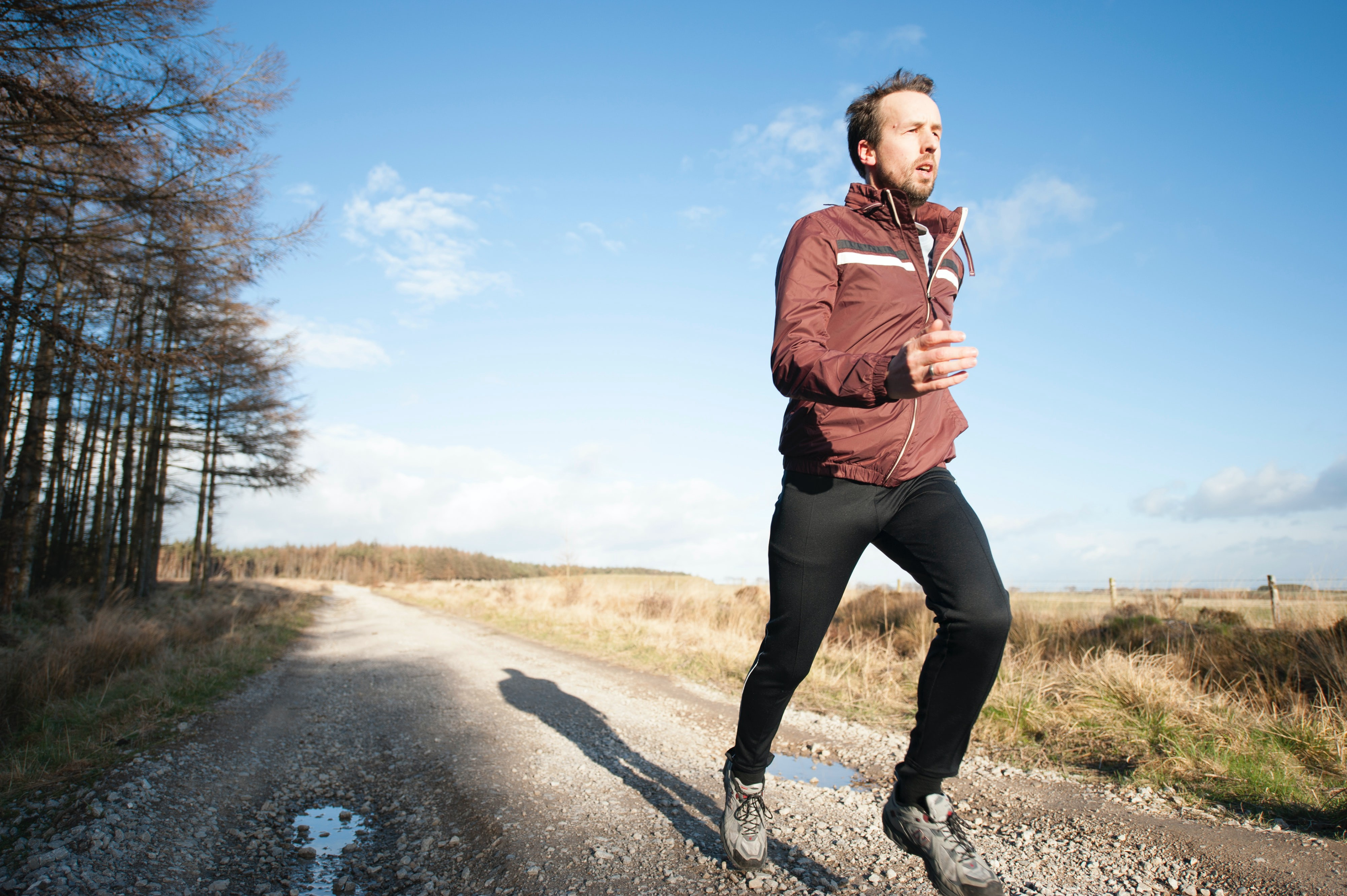 Man running along a country path