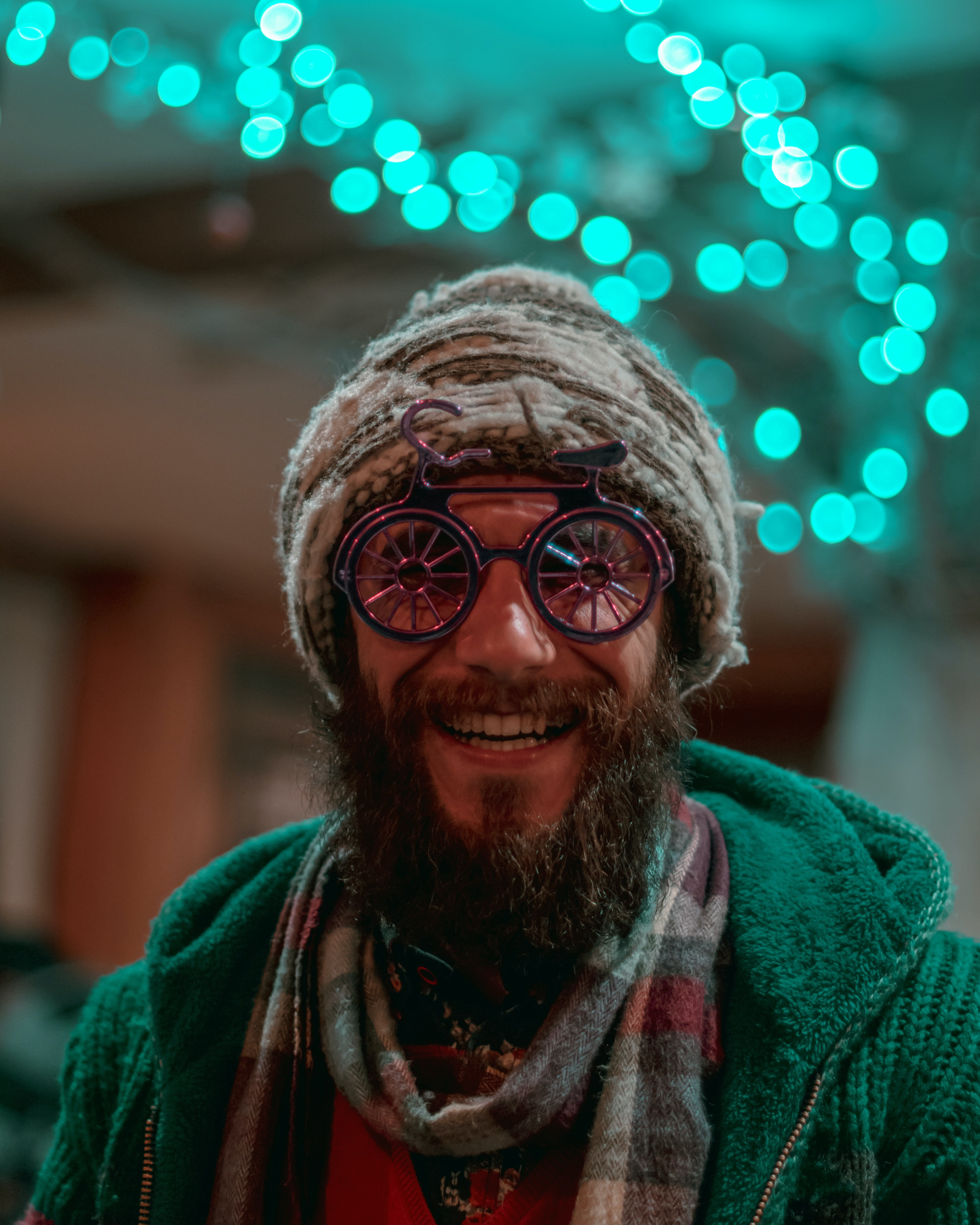 Photo by Armin Lotfi on Unsplash. Goofy, fun looking bearded buy with wacky glasses on smiling