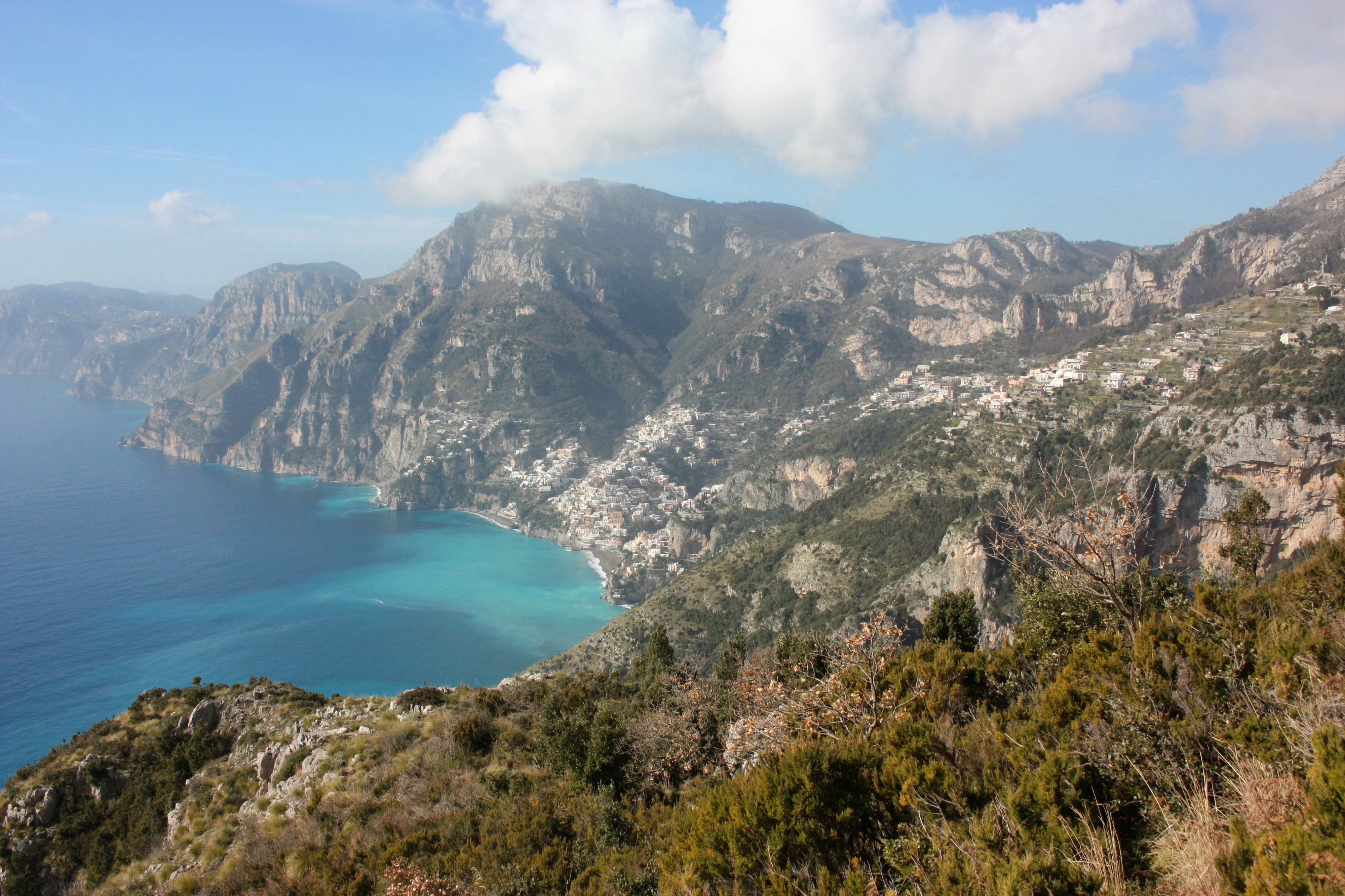 The peninsula of the Amalfi Coast, with sky-blue water and steep cliffs