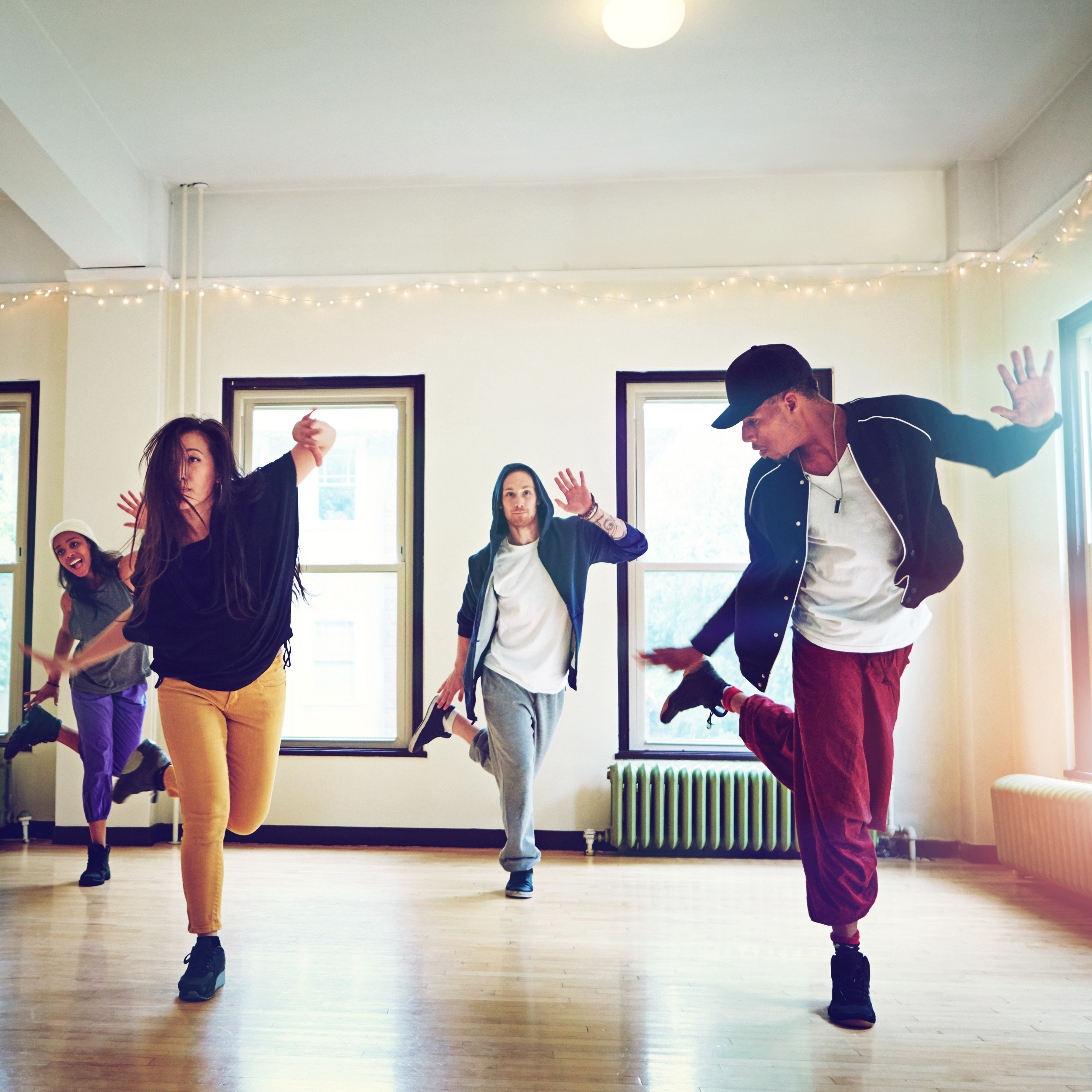 A group of young people dancing together in a studio