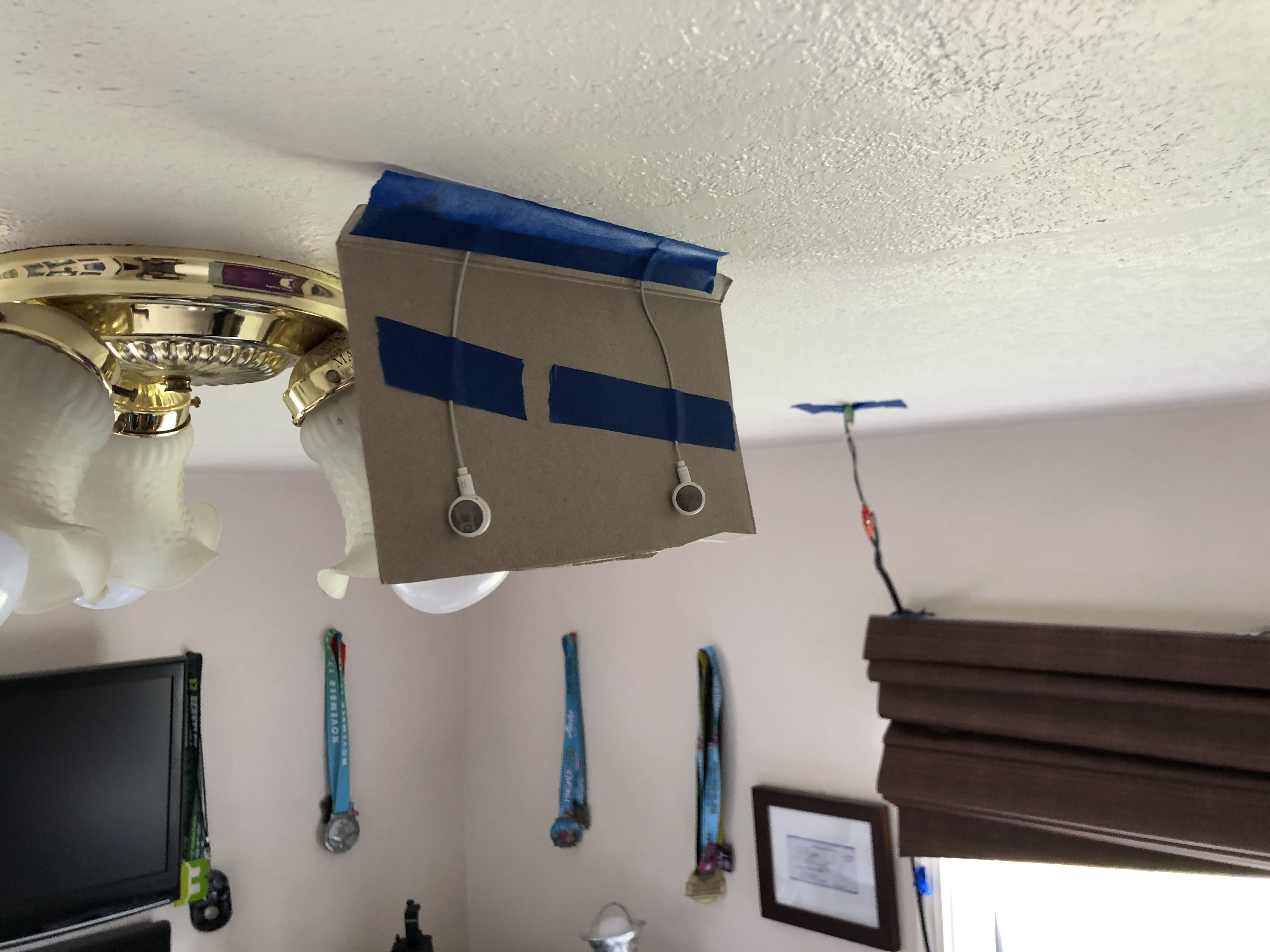 Earbuds hanging from the ceiling.