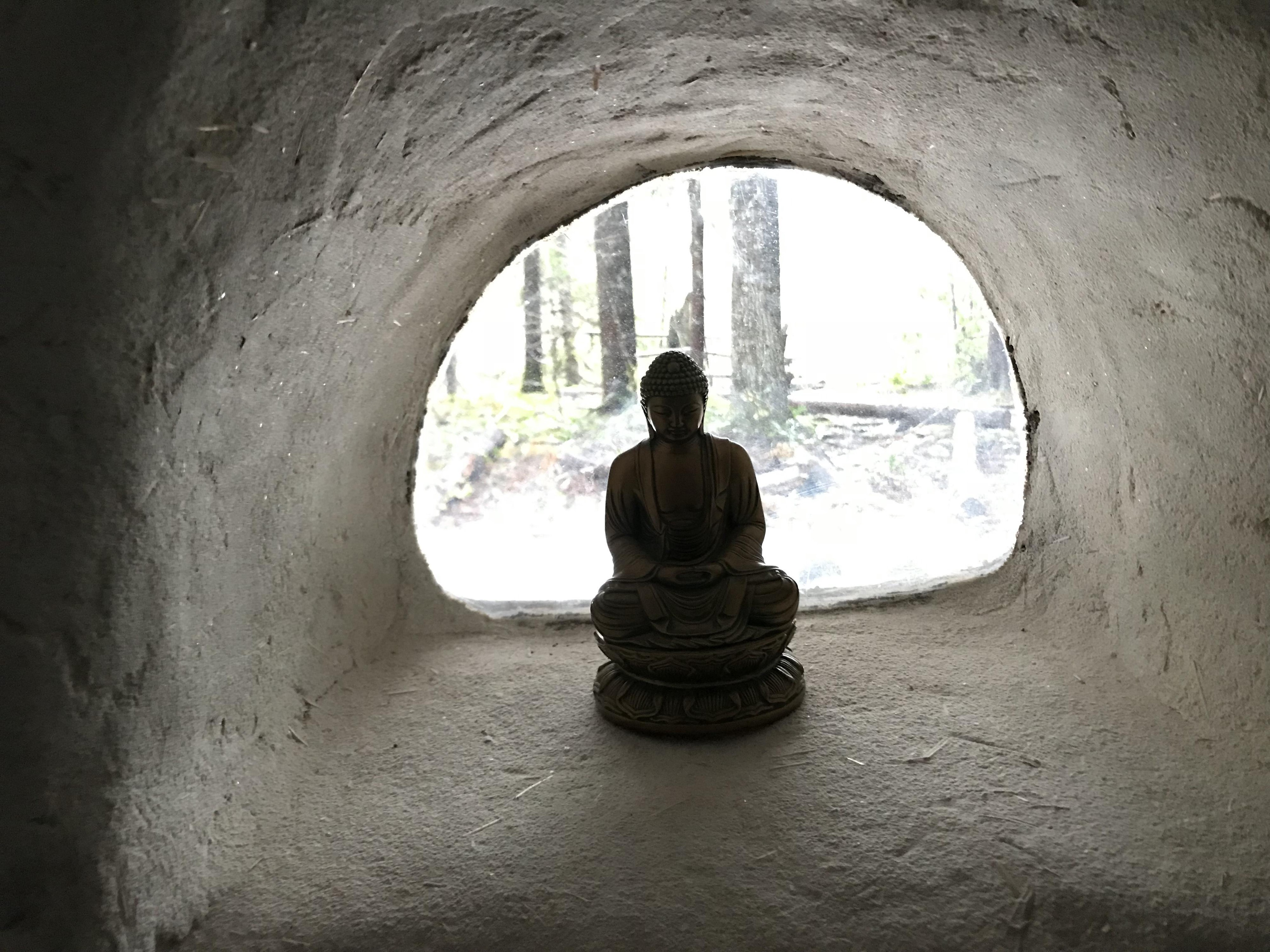 a moment of presence — meditating at the entrance to a cave