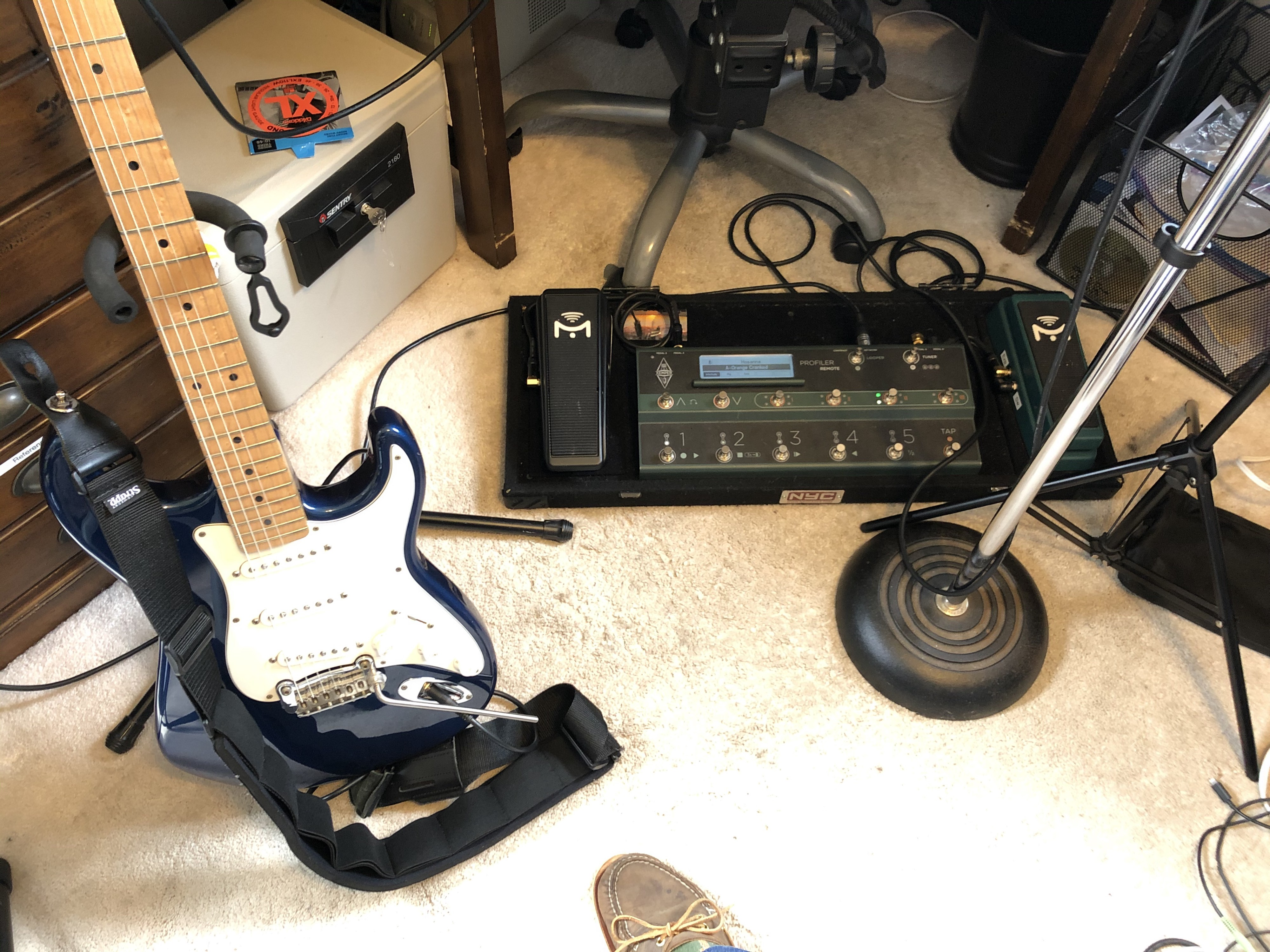 Electric guitar and guitar effects floor board.