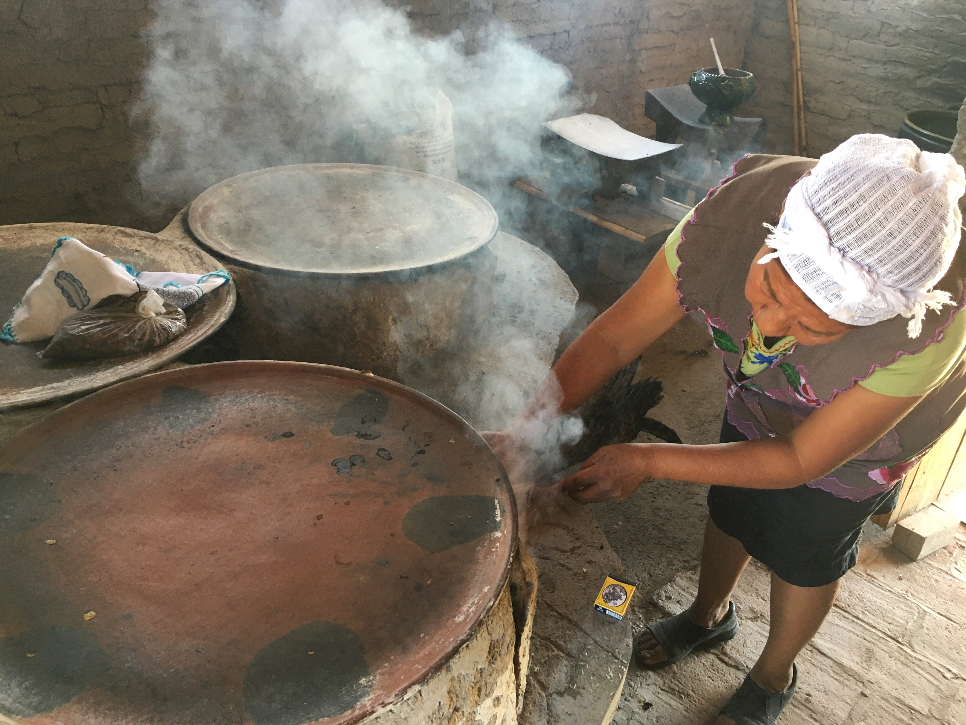 A woman prepares to roast cocoa beans at her chocolate factory, Lanní Chocolate, in Oaxaca, Mexico.