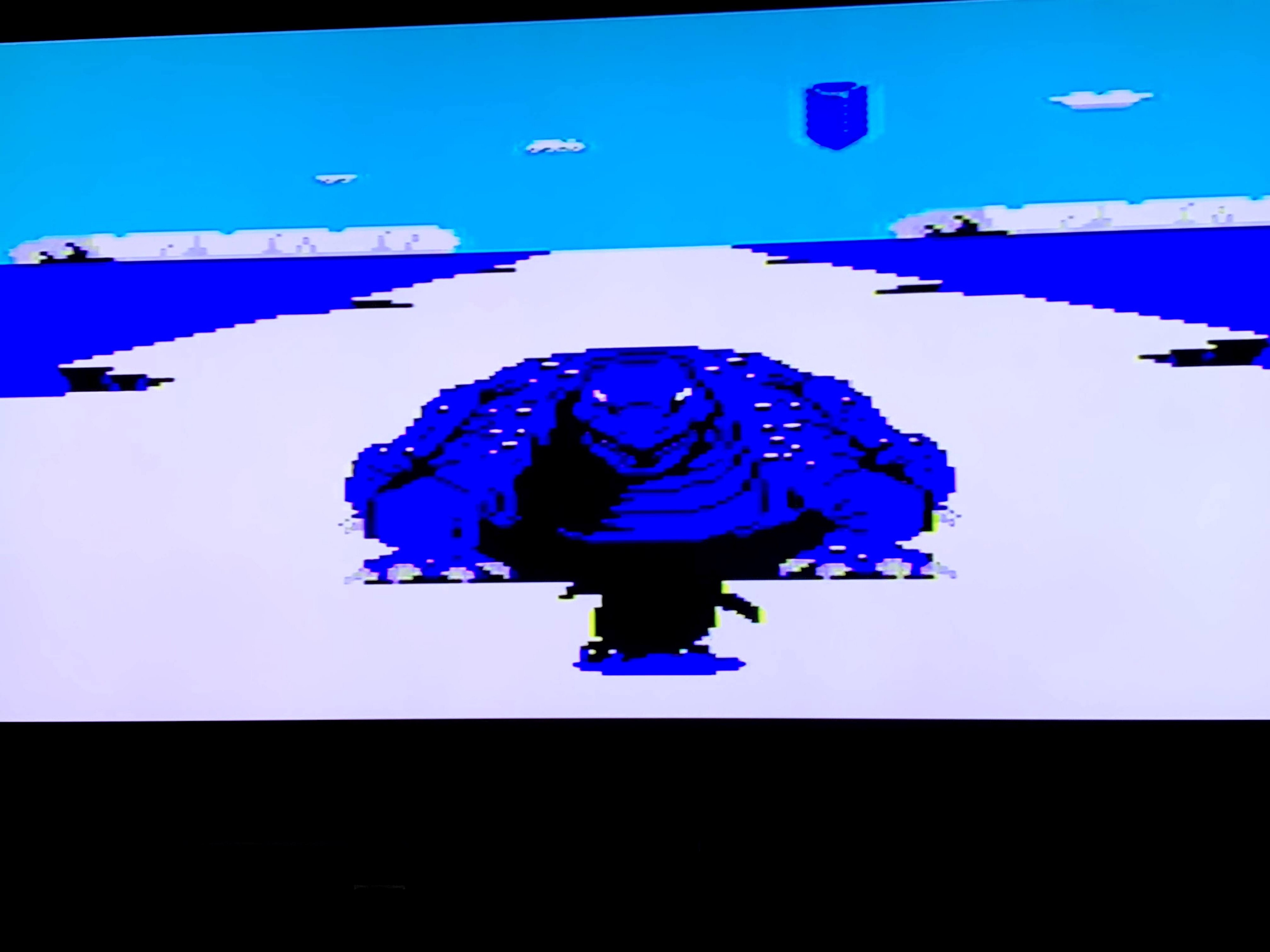 Blue Godzilla-like/lizard creature that the penguin encounters in the first boss level.