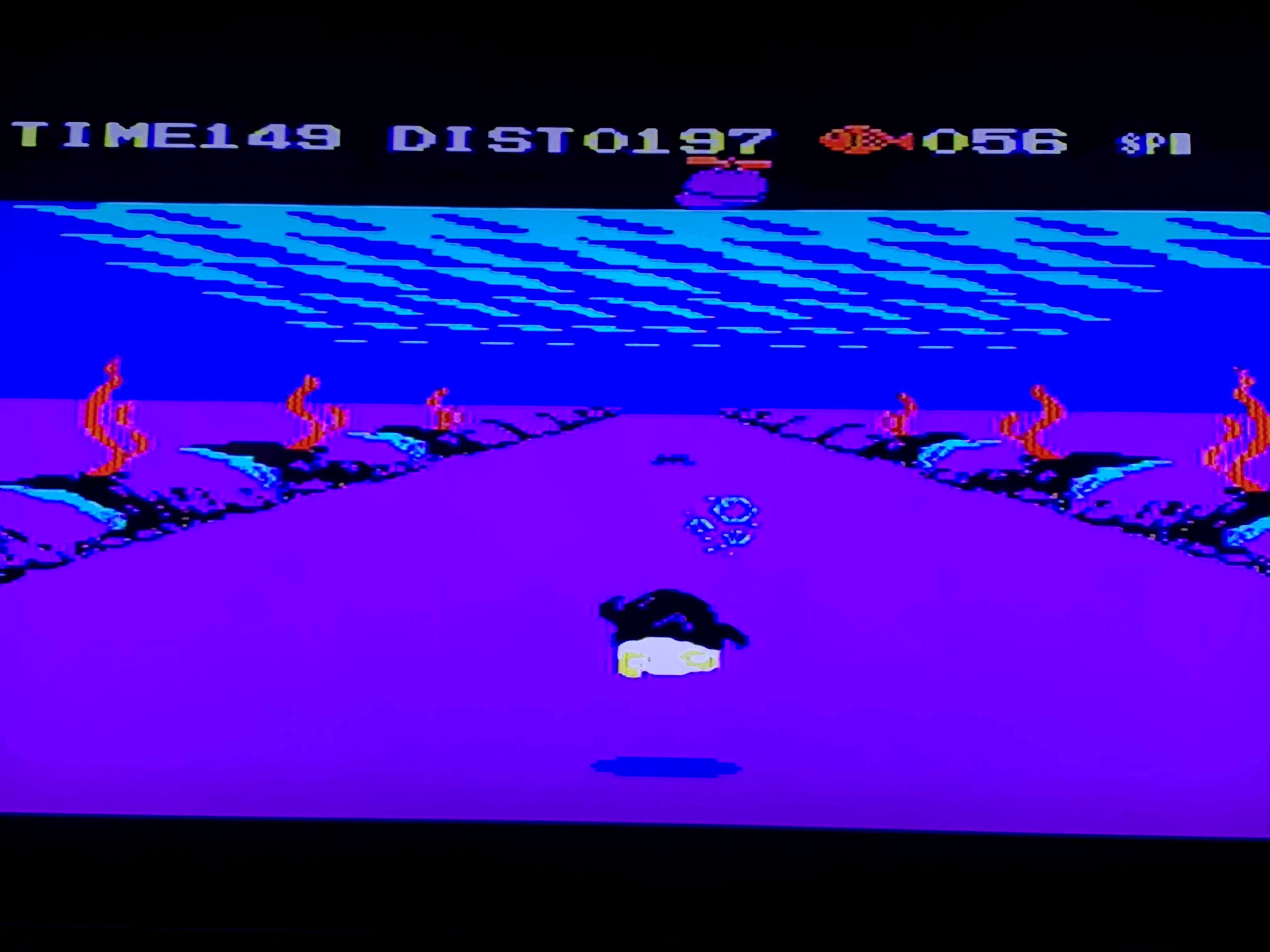 A scene from Penguin Adventure where the penguin is swimming at the bottom of an ocean.