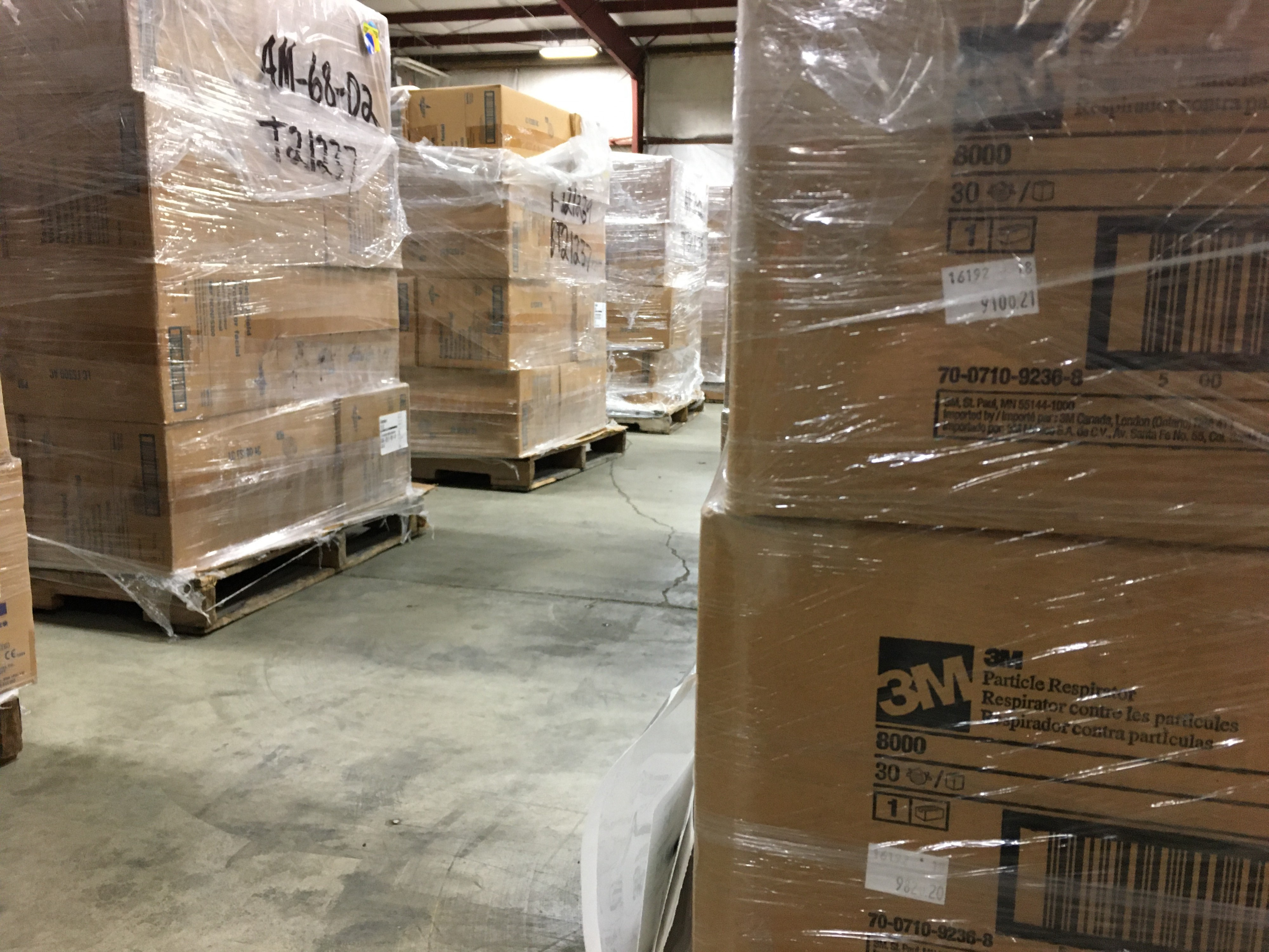 Row of boxes full of PPE.