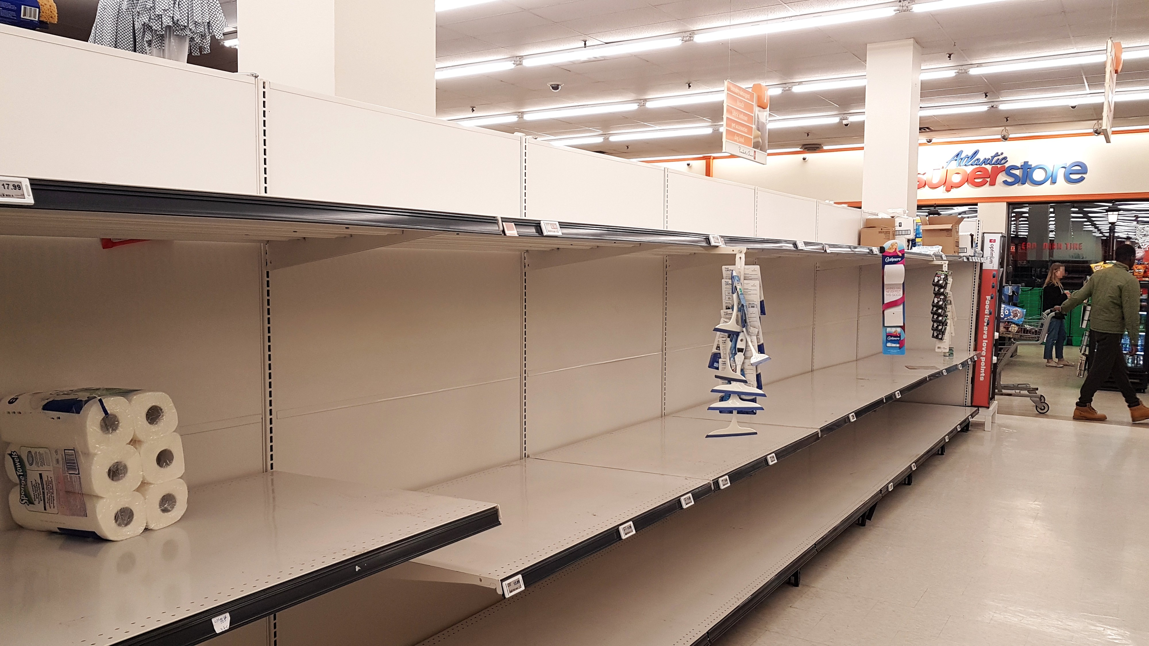 Empty shelves in the toilet paper aisle of an Atlantic Superstore supermarket of Halifax, Nova Scotia, Canada, on 12 March 20