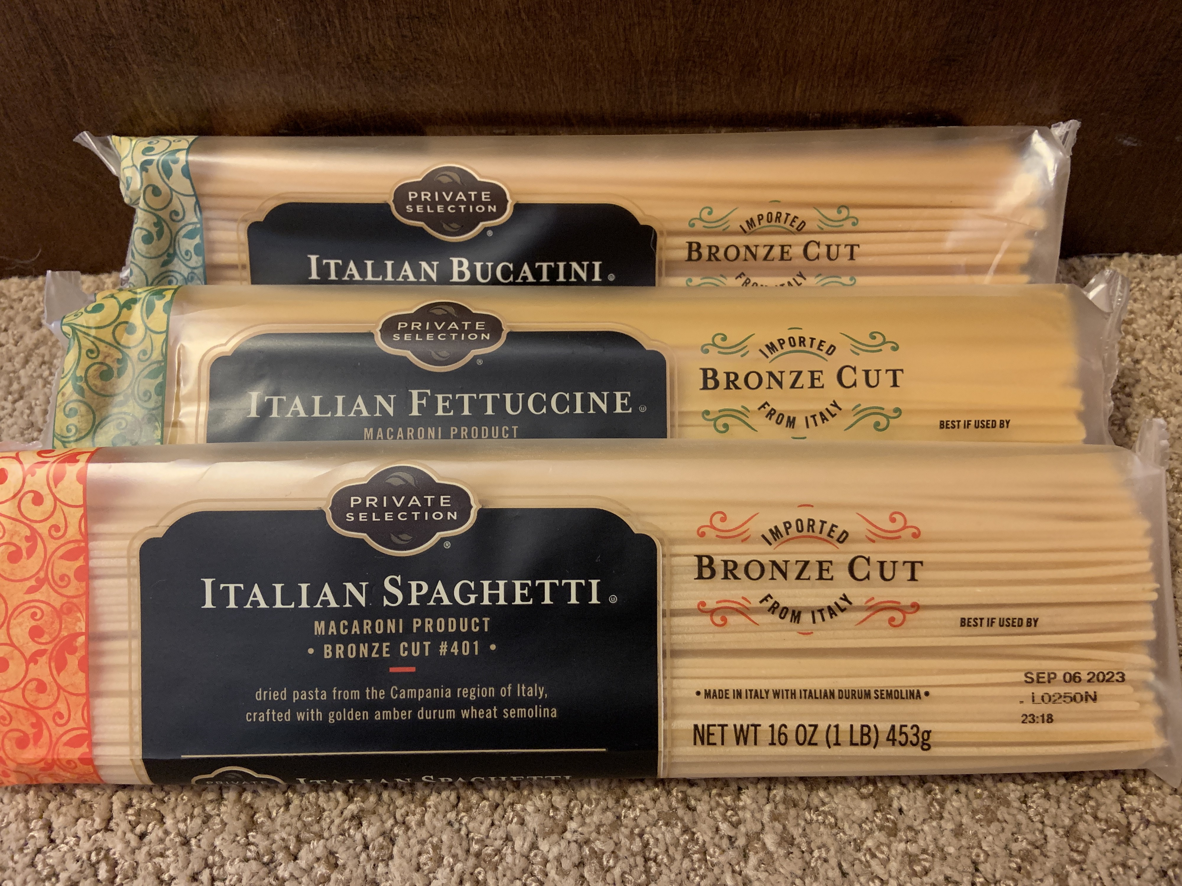 Three kinds of uncooked noodles: spaghetti, fettuccine, and bucatini, all from King Soopers Private Selection.
