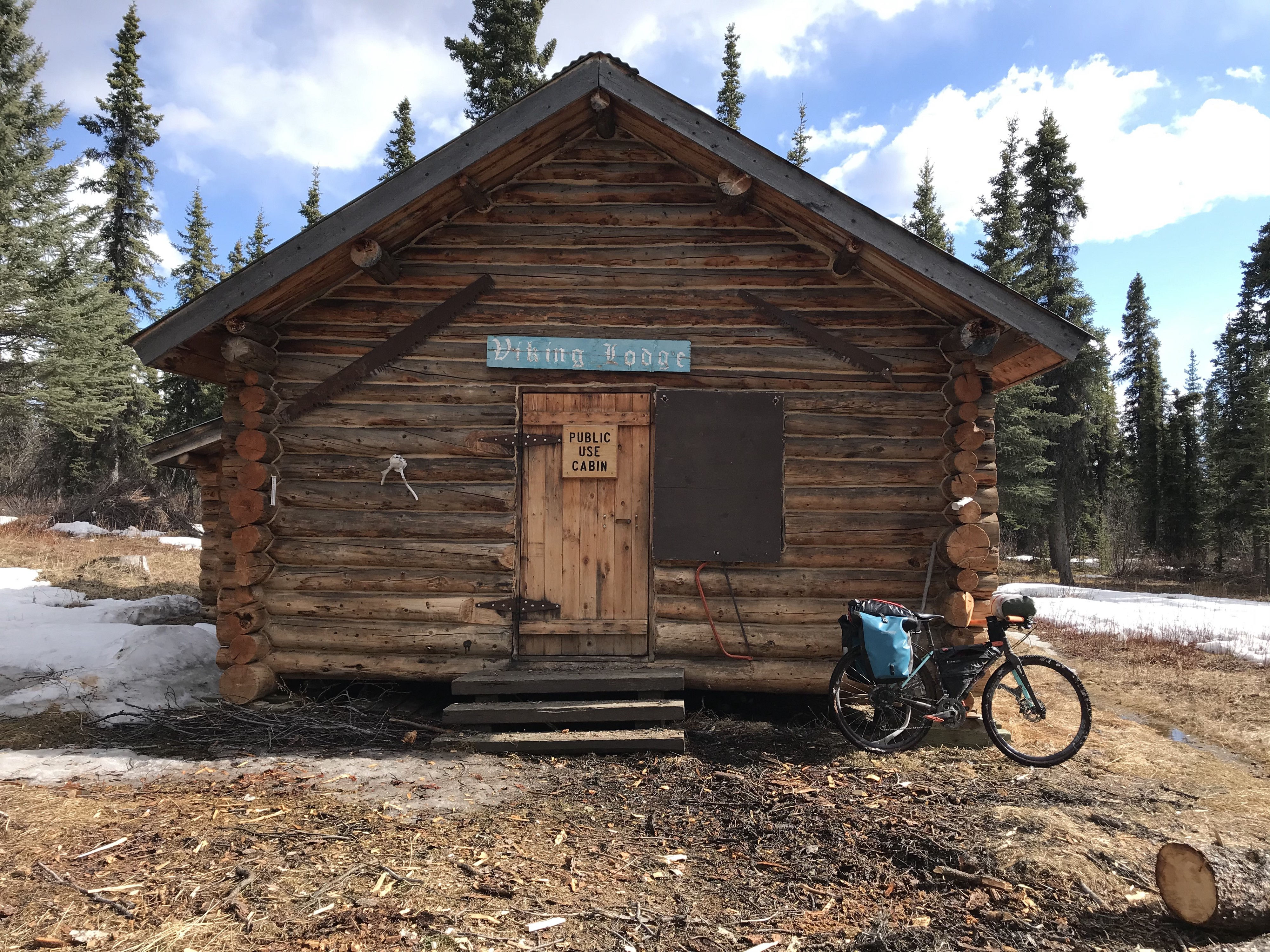 Bike propped up against the Viking Lodge, an old cabin.