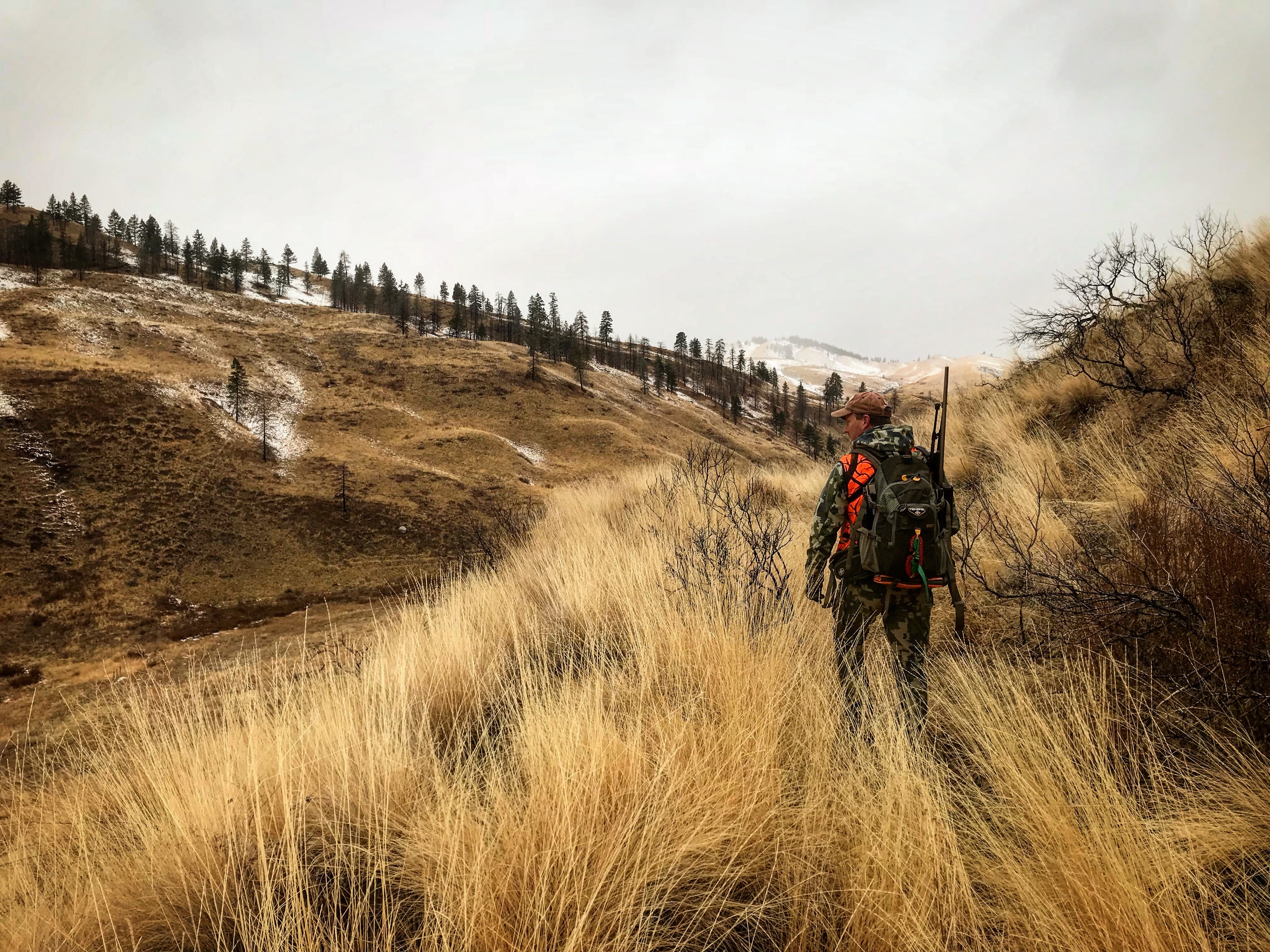 A deer hunter enjoys the beautiful country and public land opportunity of WDFW's Methow Wildlife Area in Okanogan County near Winthrop. (Kevin Puzey)