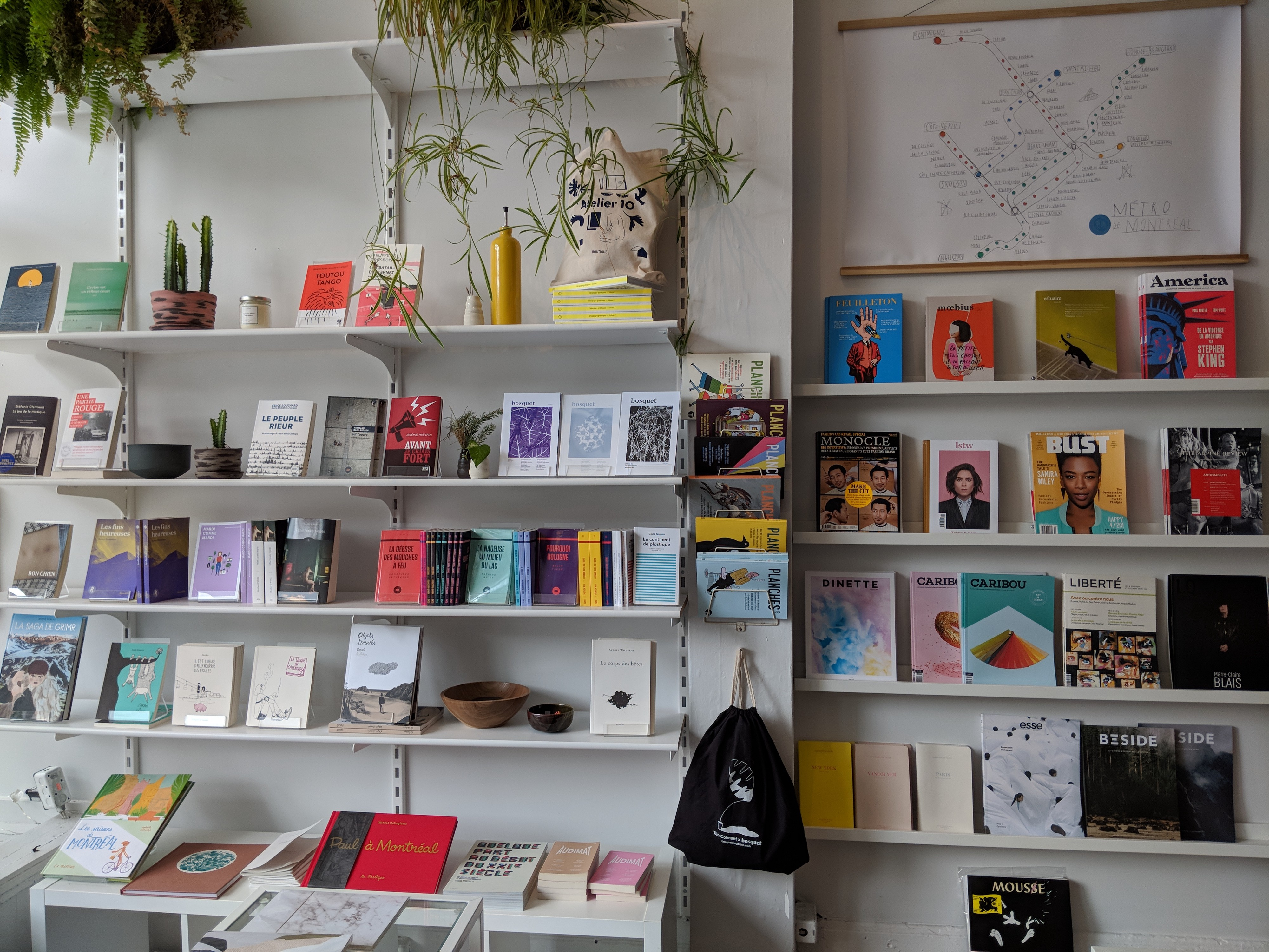 Shelves of books, magazines, and stationary displayed in a bookshop in Montreal.