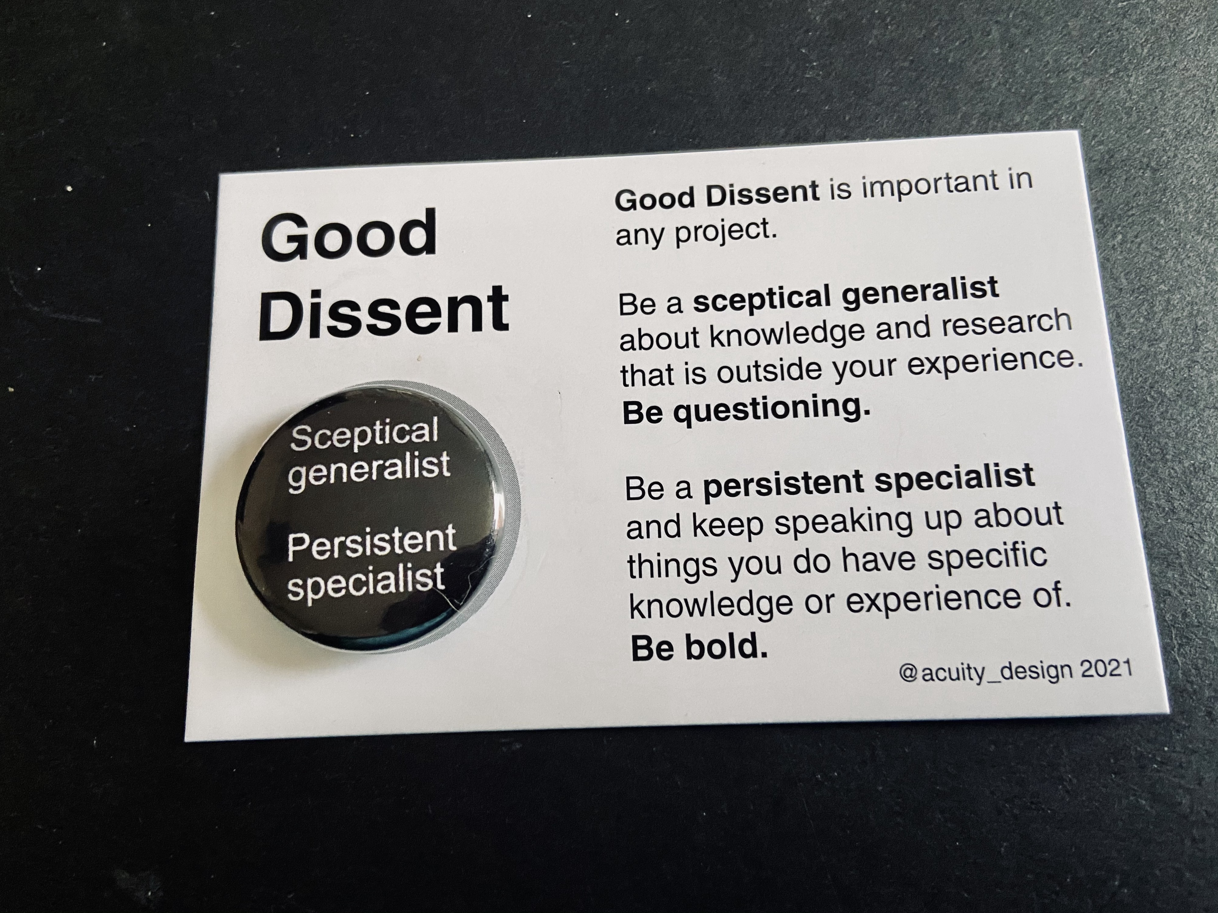 Good Dissent badge on backing card