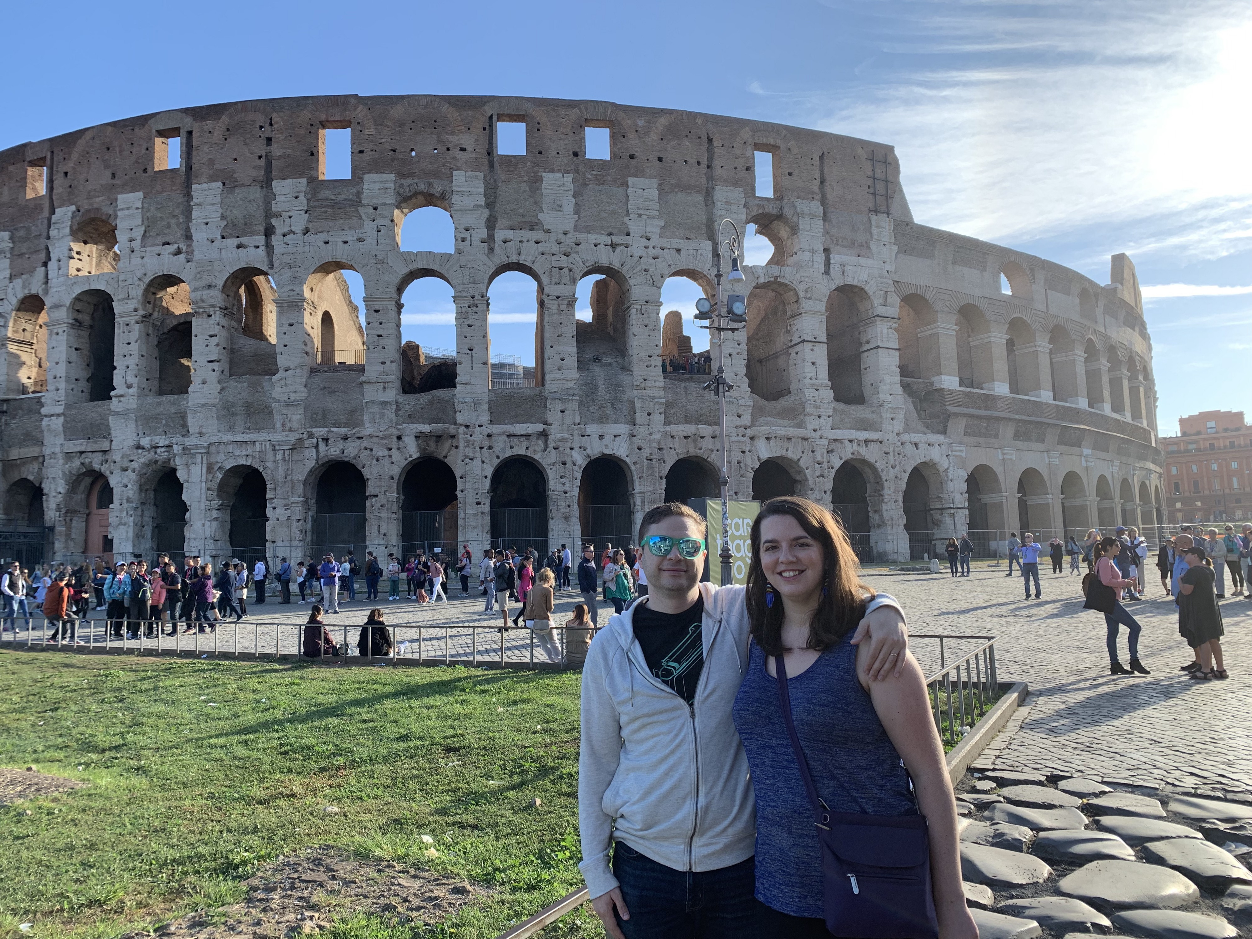Tim and Megan pose in front of the Colosseum in Rome, Italy.