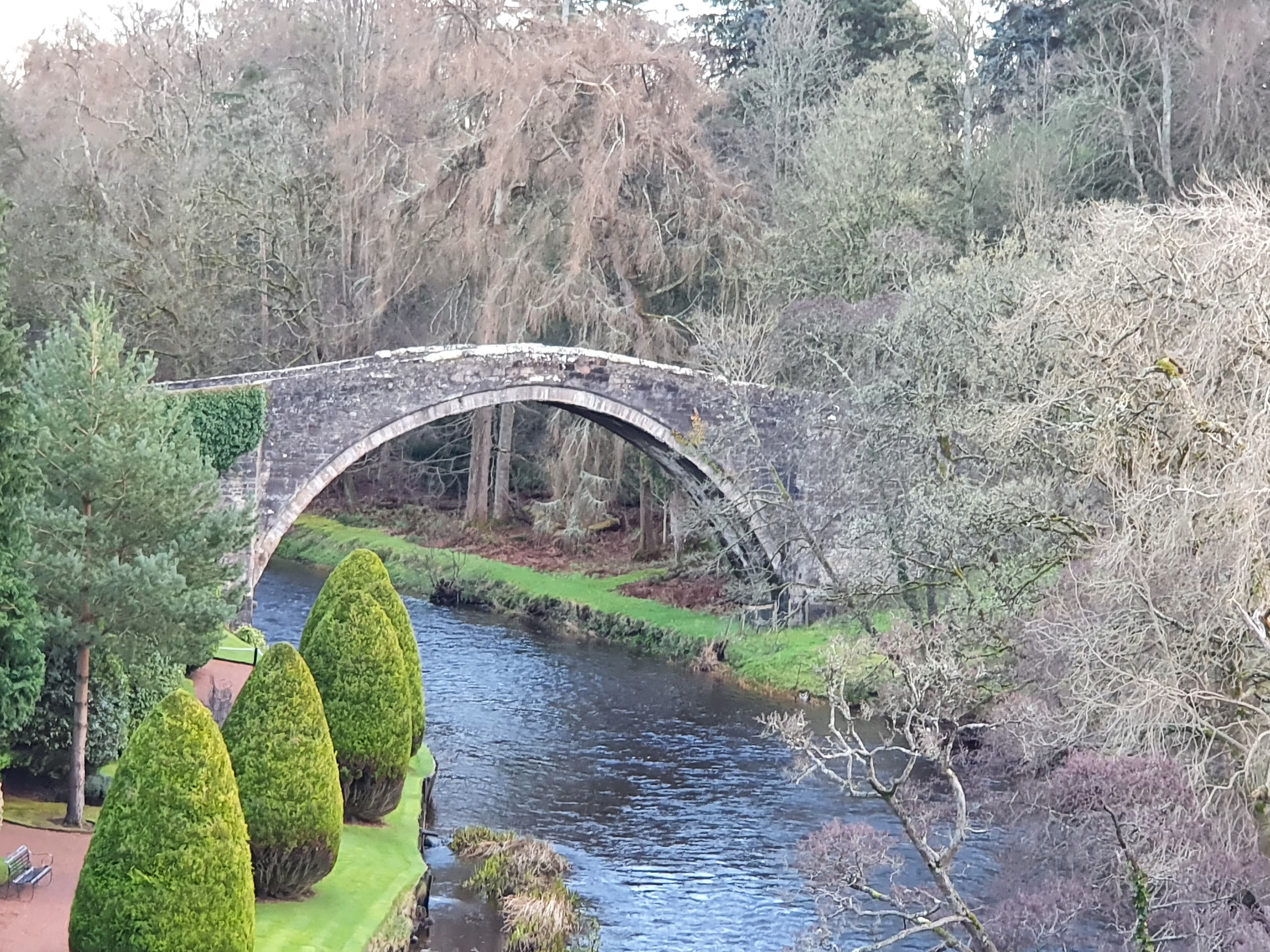 The bridge over the River Doon 'Brig O Doon' can be seen spanning the river in the middle distance.