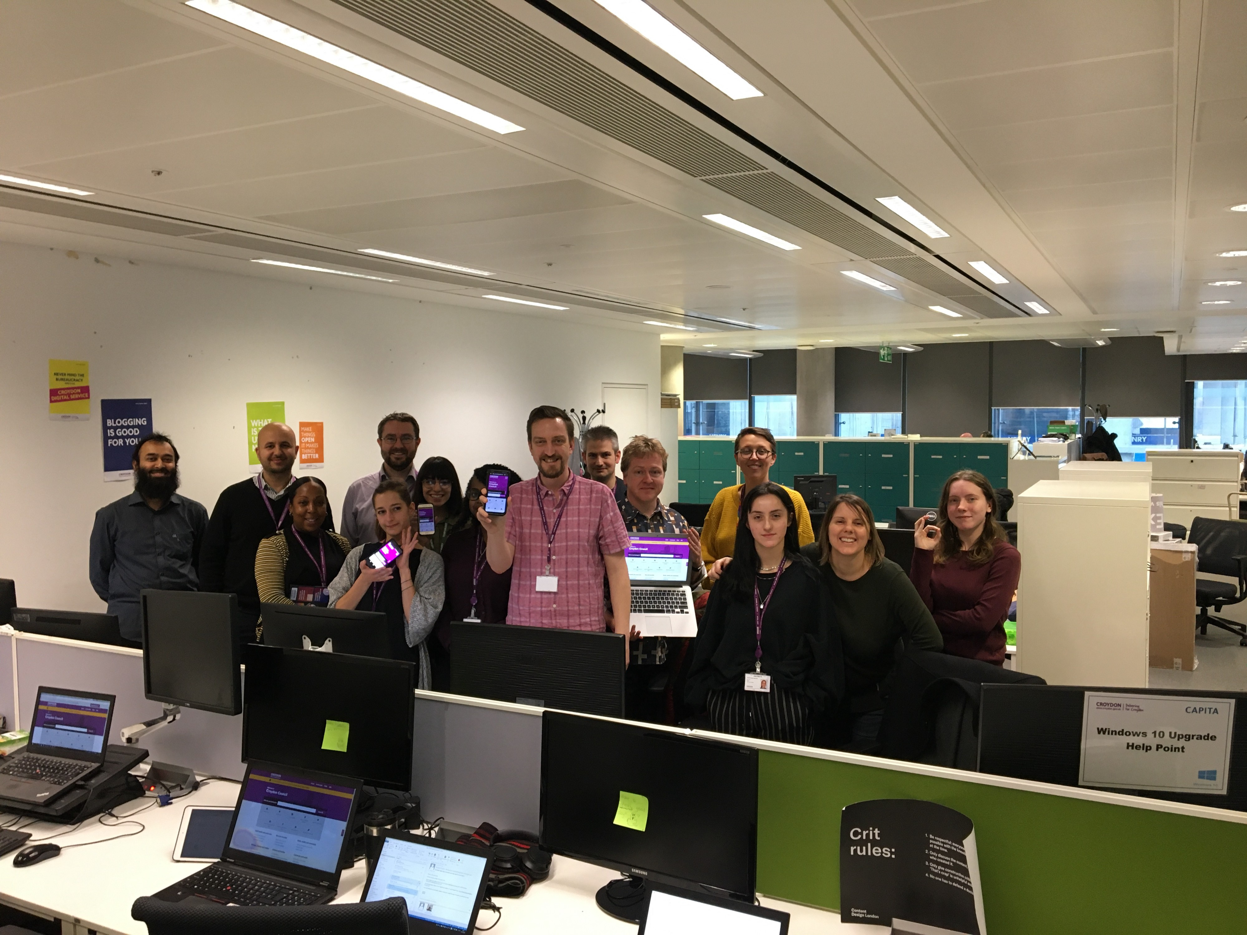 The team 5 minutes after new website go-live, proudly displaying it on all the screens!