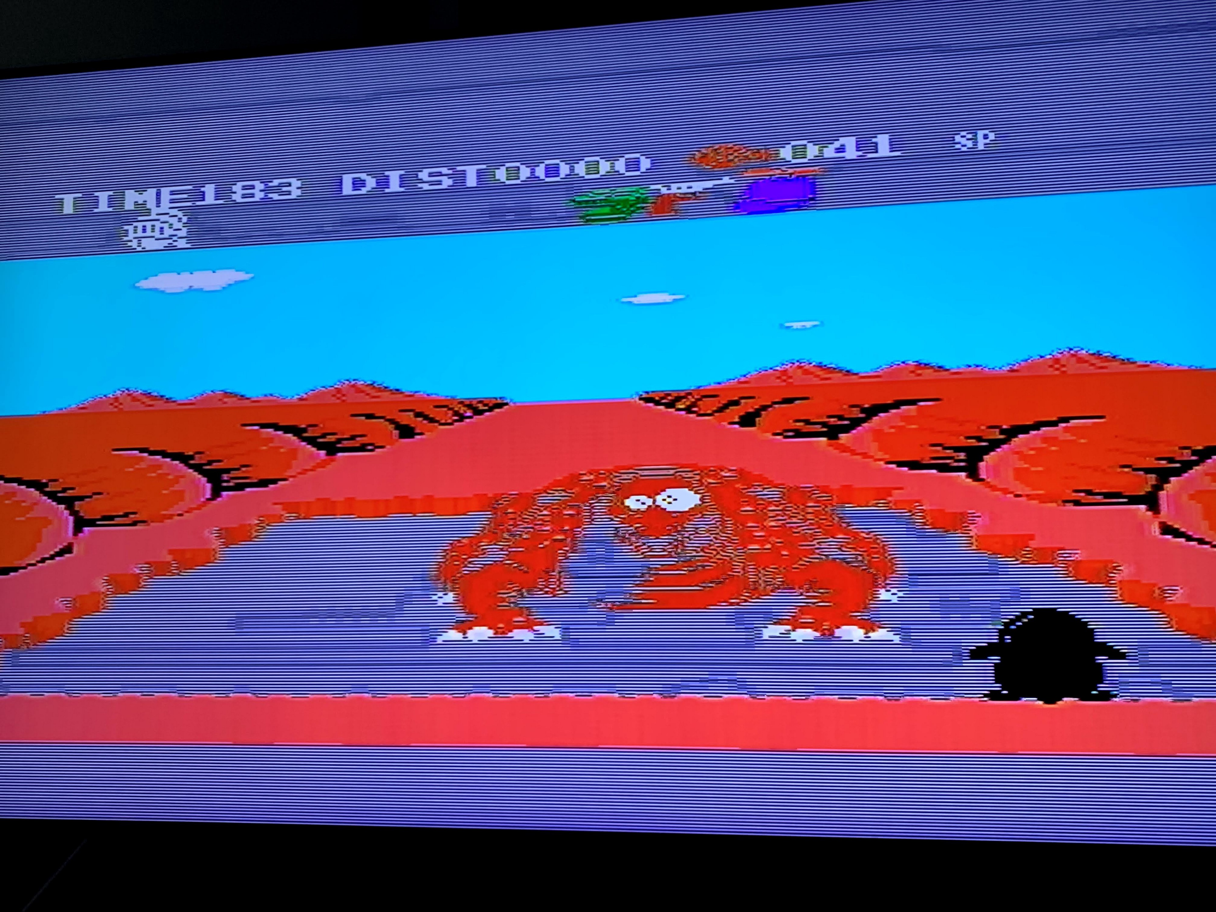 Beating one of the boss rounds in Penguin Adventure. A Godzilla-like creature is about to fall into a hole in a desert.