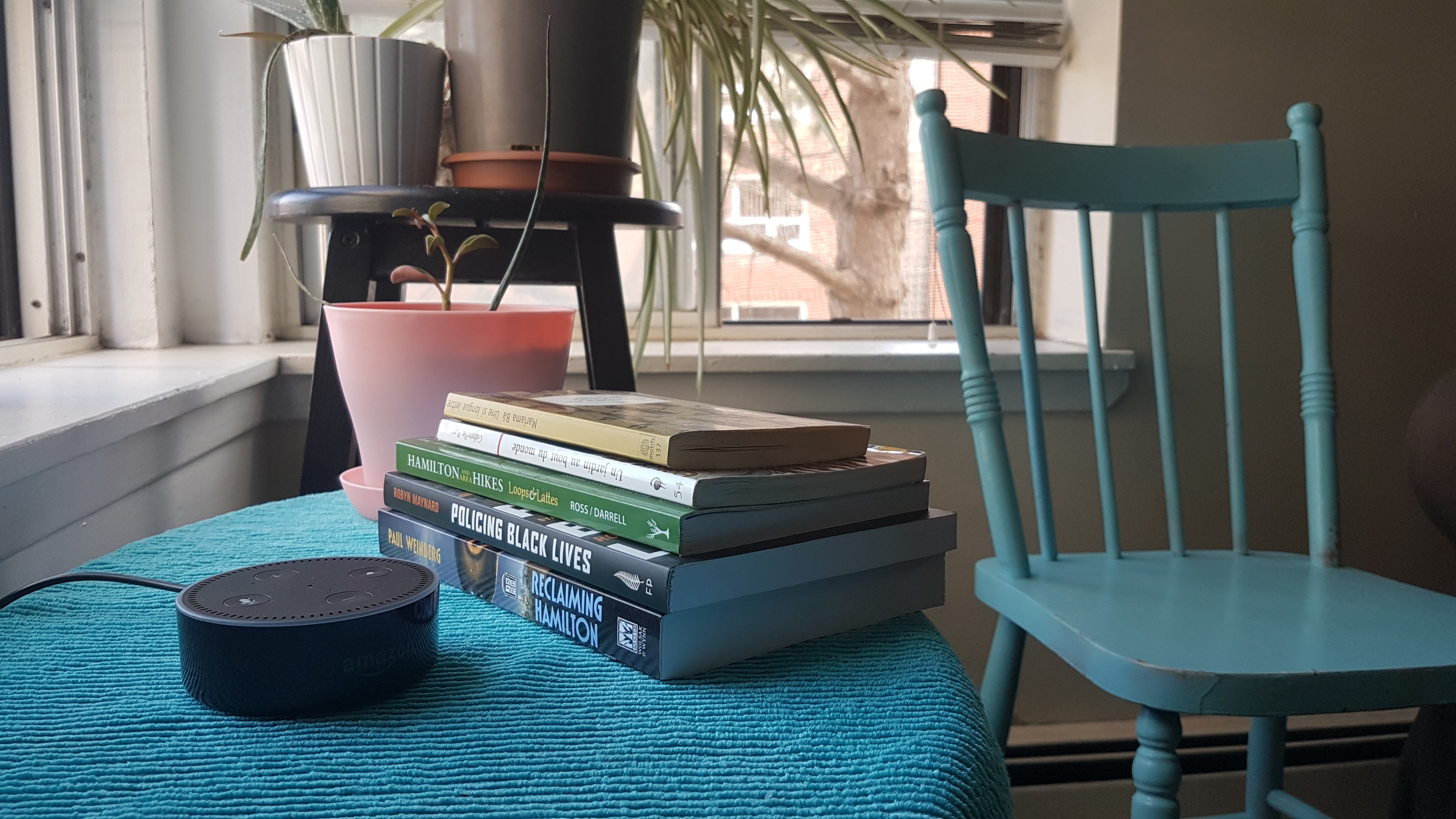 Photo of Amazon Echo Dot 2, on coffee table with books