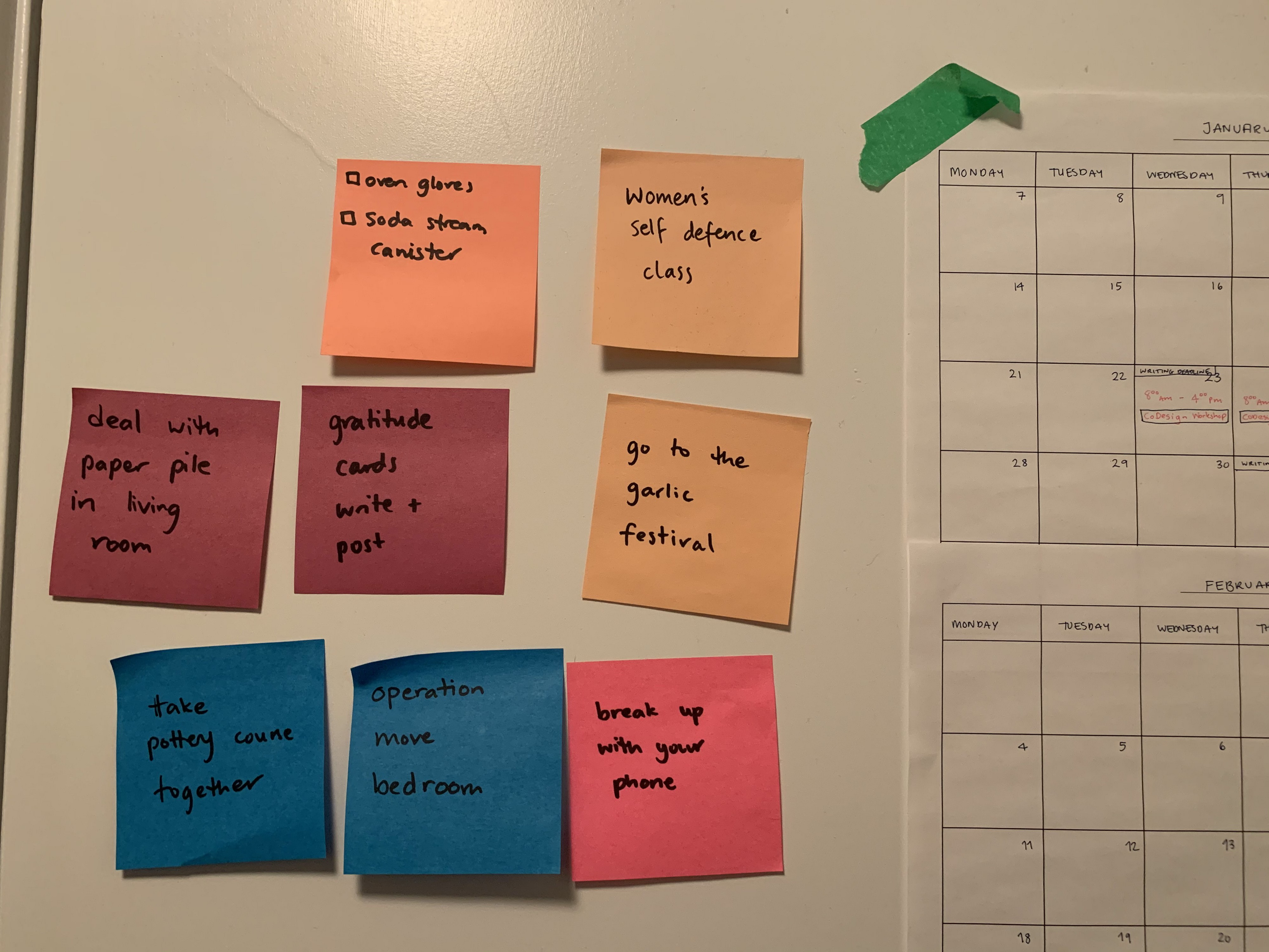 Various tasks on post its beside a calendar. Including go to garlic festival, and women's self defence class.