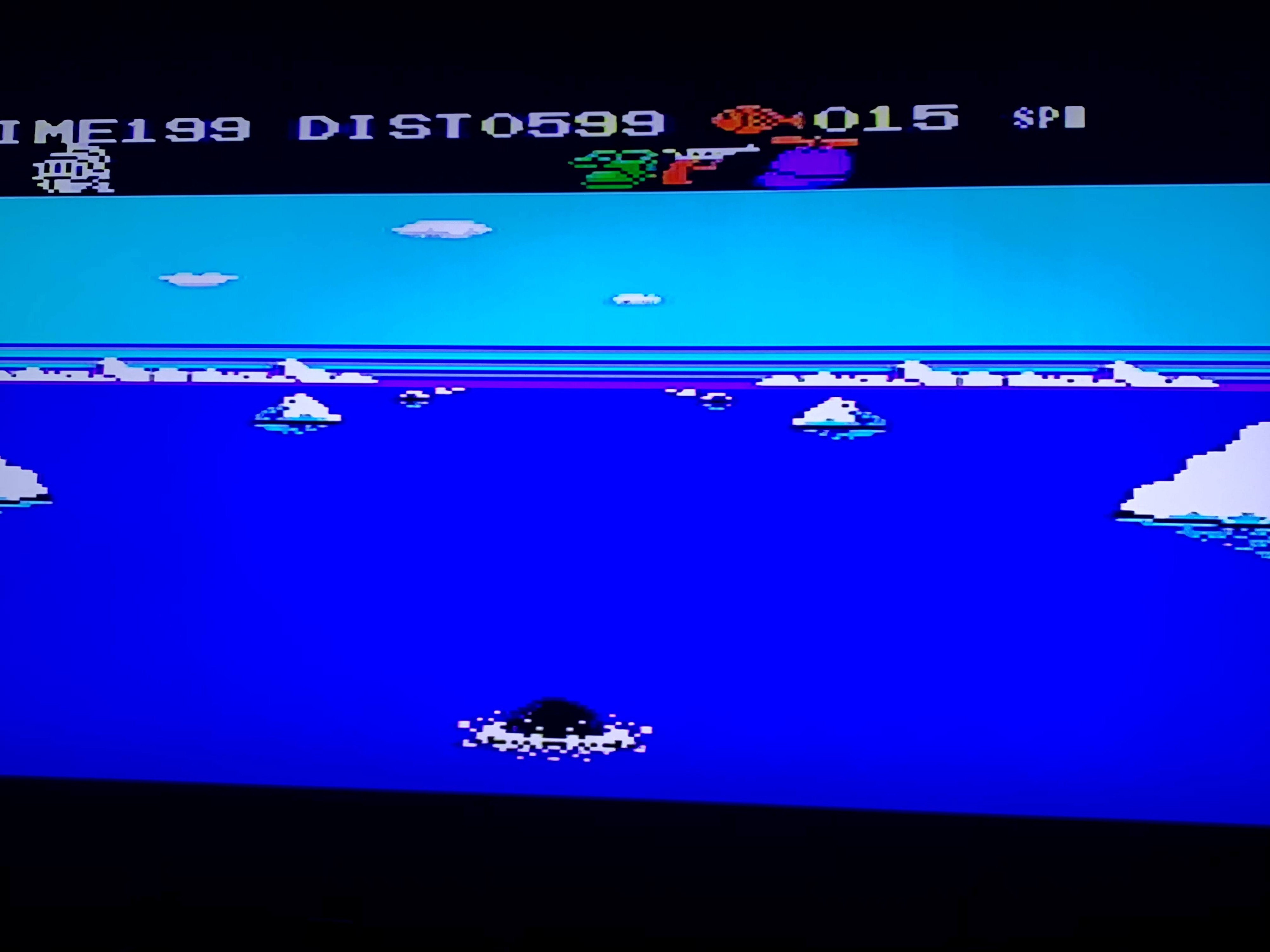 A scene from Penguin Adventure. The penguin is swimming through an arctic lake or ocean.