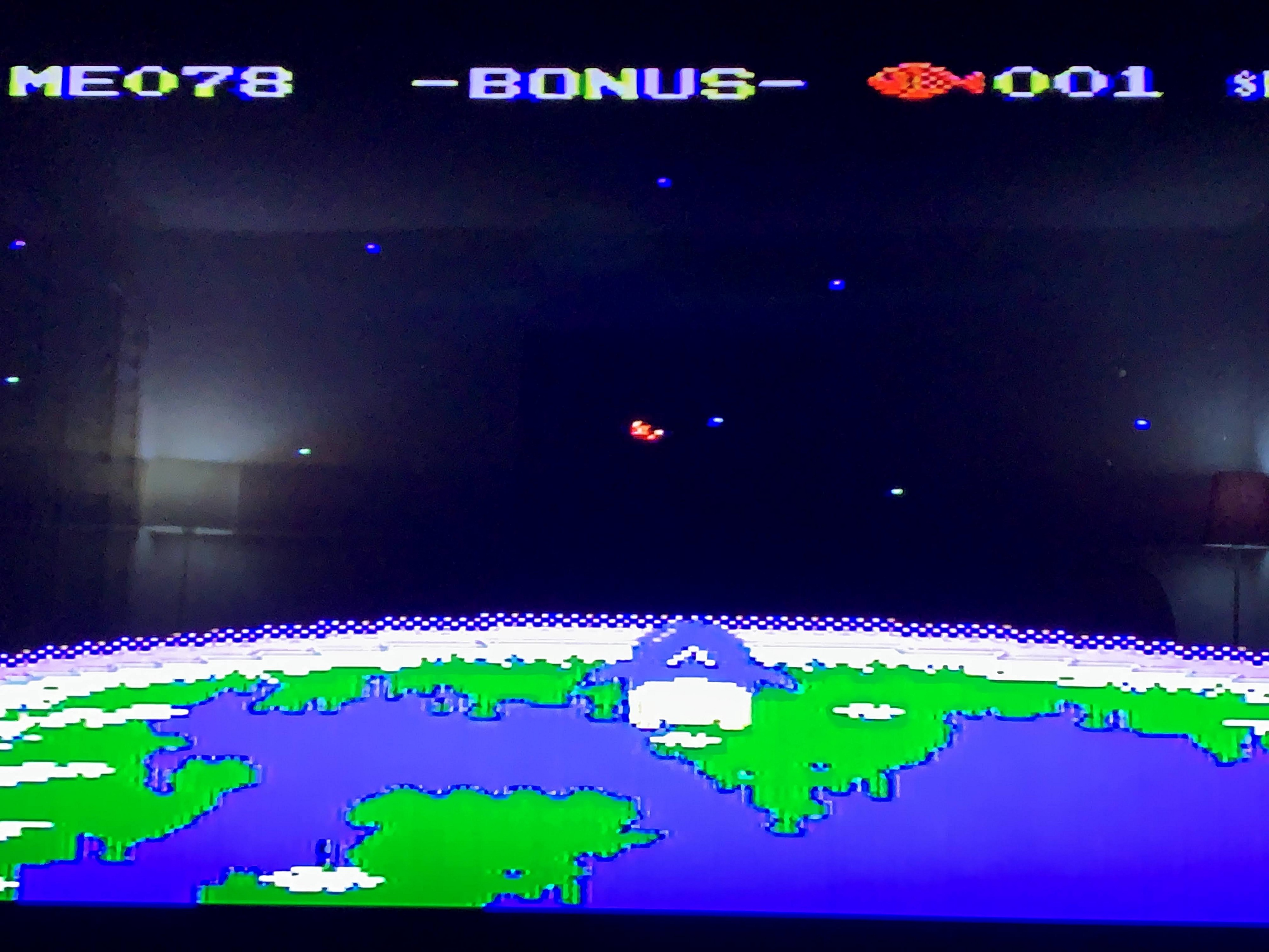 Bonus round shows a penguin flying over the earth with a fish coming towards him.