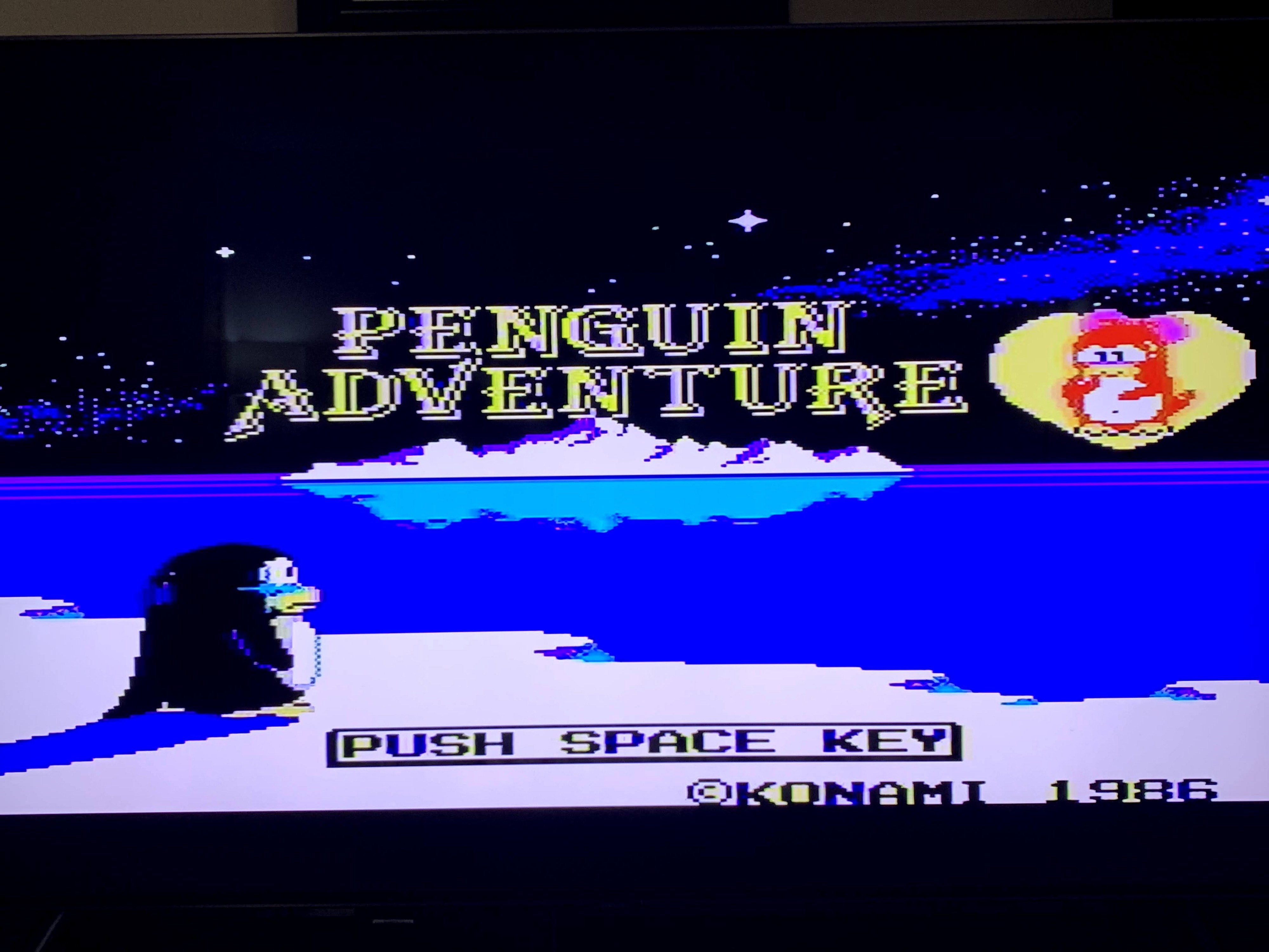 Start screen for Penguin Adventure shows a penguin tearfully staring at a heart with a penguin princess in the distance.
