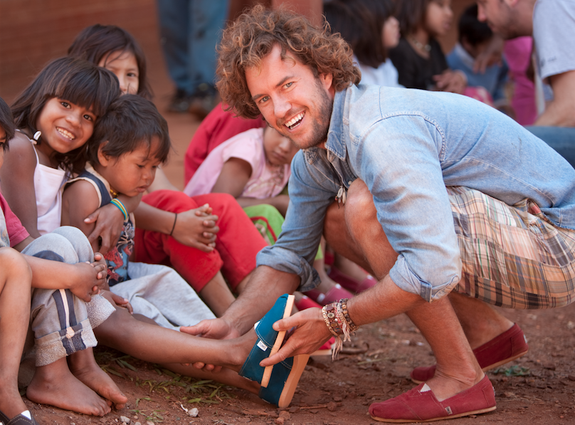 Image result for toms shoes giving