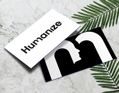 An artistic index card with humanize, and some leaves