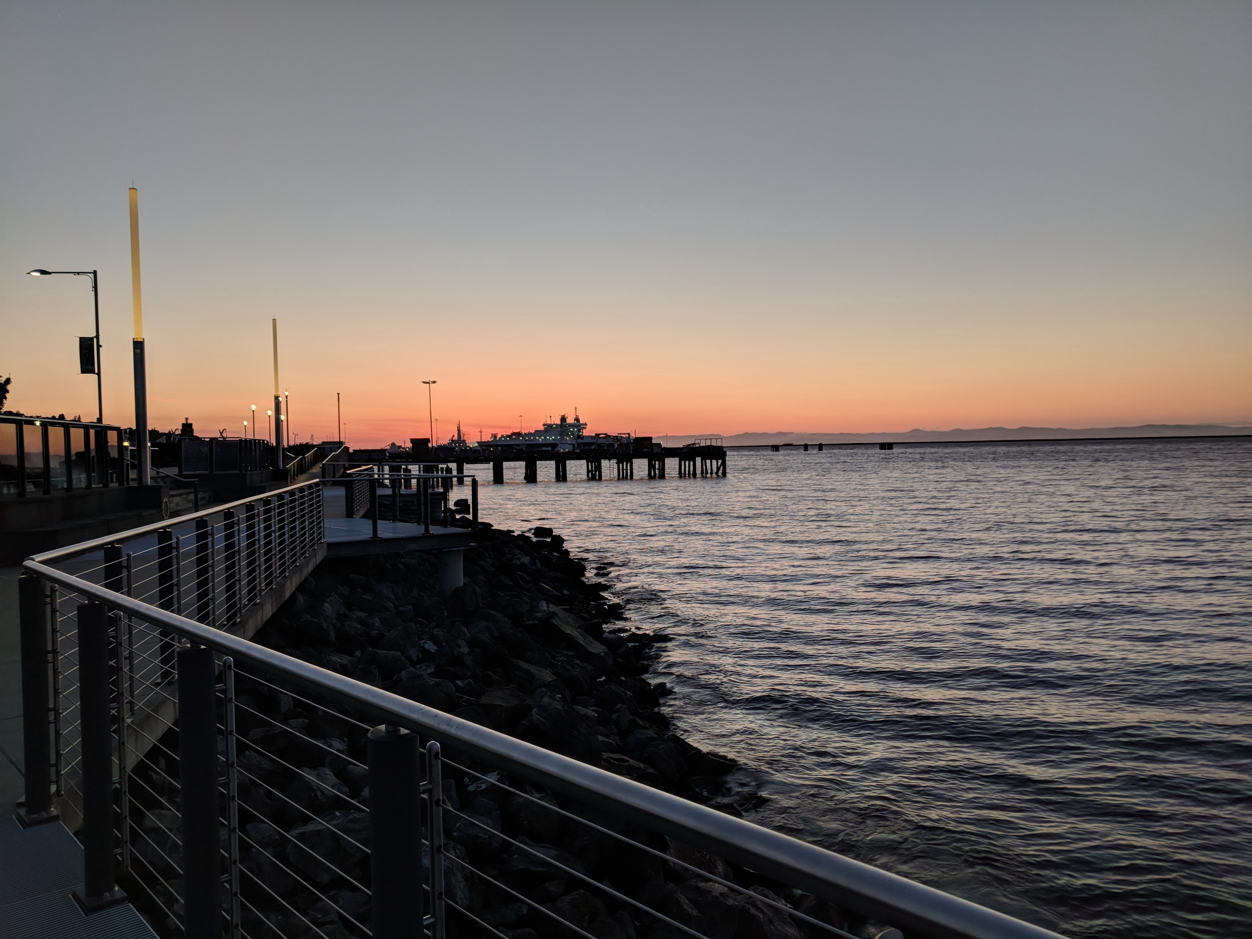 Picture of a dock and boat at sunset