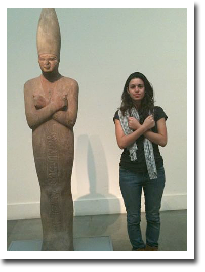 Lady mimicking the pose of a statue