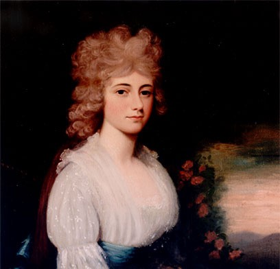 Louisa Adams in a muslin dress with a blue sash. Her ash-blonde hair is thick and curly.