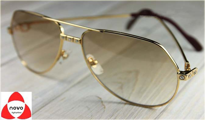 2db20a63bf54 A classic aviator shape meets ultra-light frames with iconic panther  details to create a bold and striking look. Metal sunglasses with a smooth  golden ...
