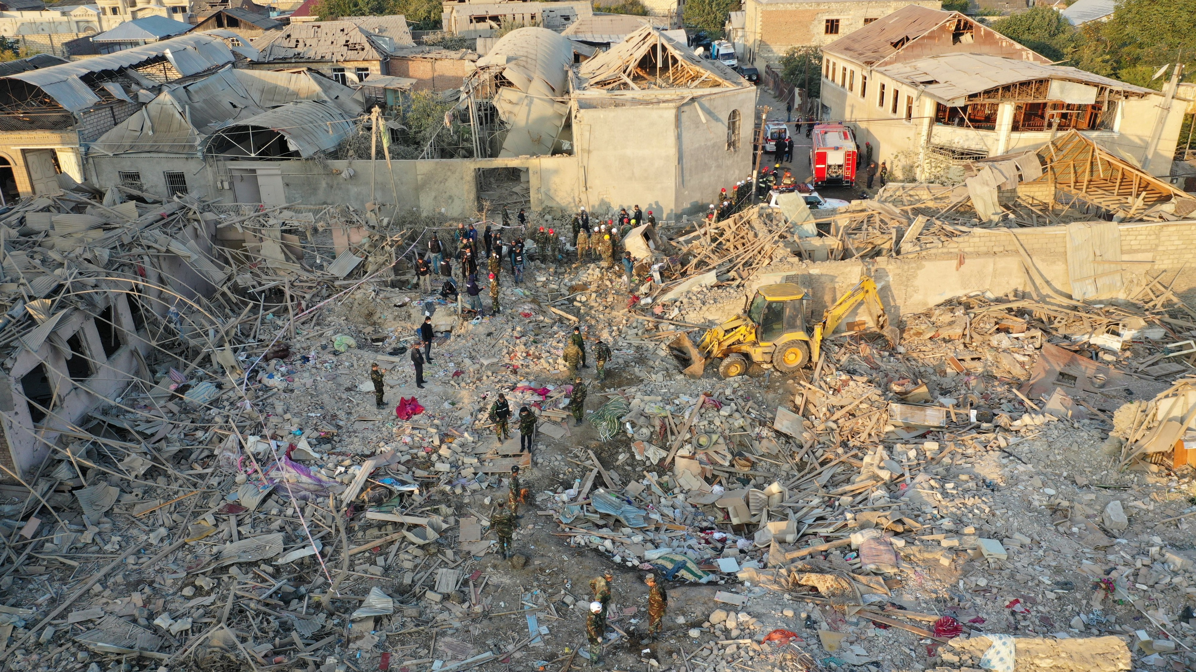 Emergency teams at work in the rubble of the latest rocket attack on Ganja, Azerbaijan, killing 13 and wounding 52