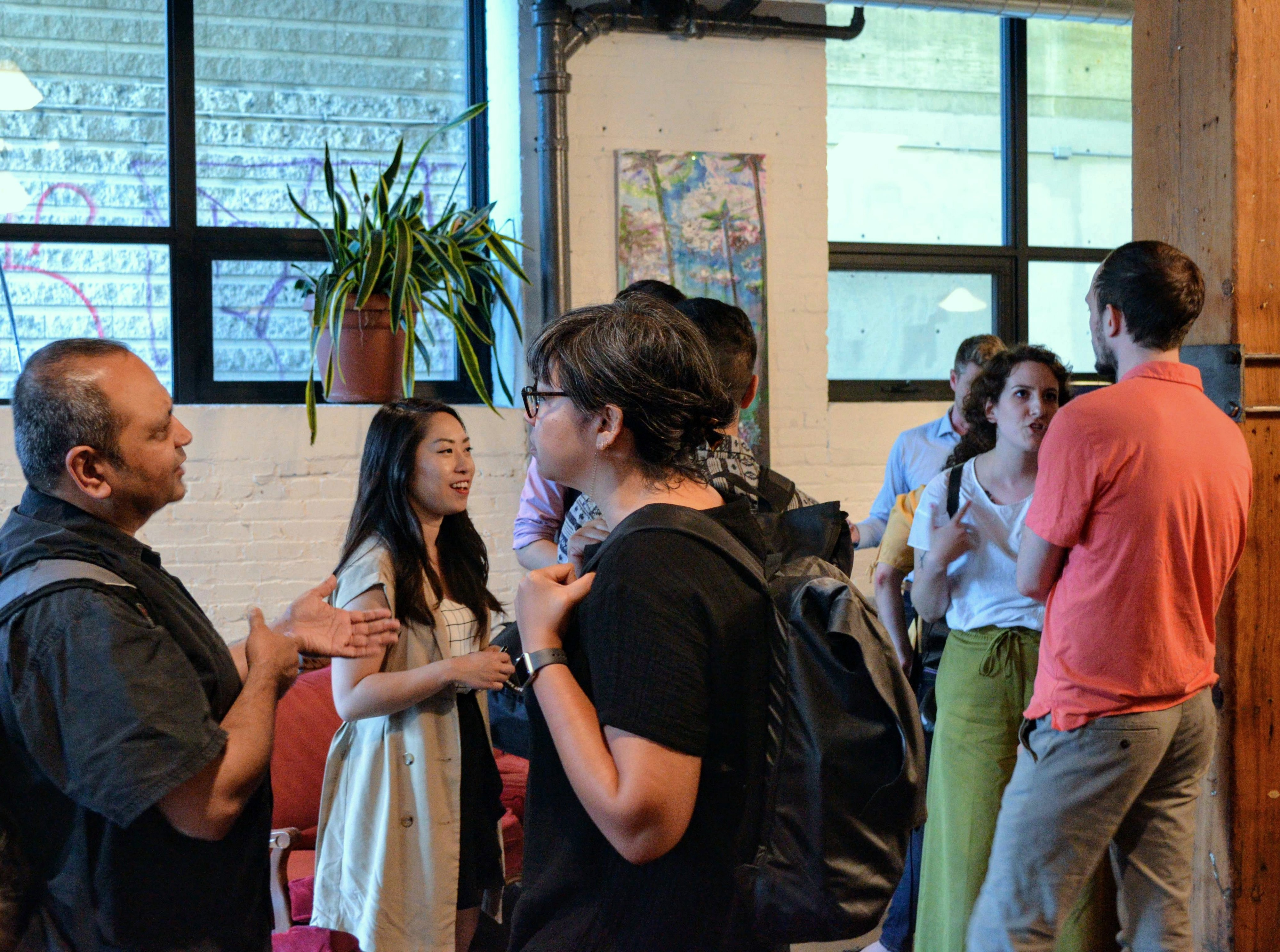 Attendees discussing with one another after our 'Data, Policy-Making and City-Building' public salon.
