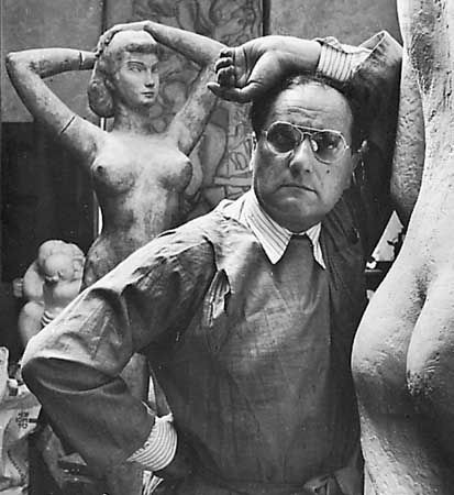 (Photograph by Arnold Neuman for Britannica.) William Zorach photographed by Arnold newman with his sculptures.