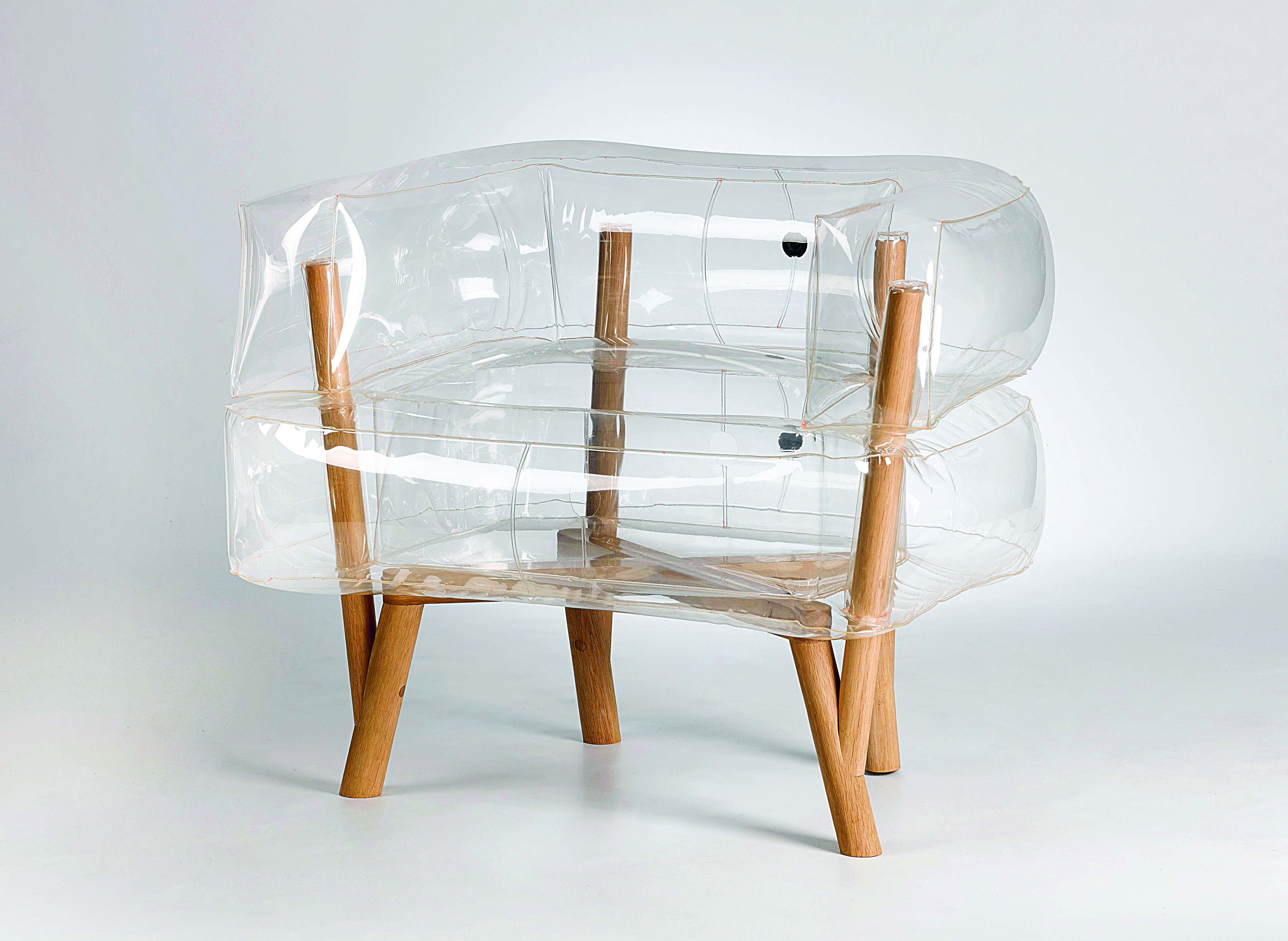 Chair with minimal wooden frame encased in transparent, inflatable cushions.