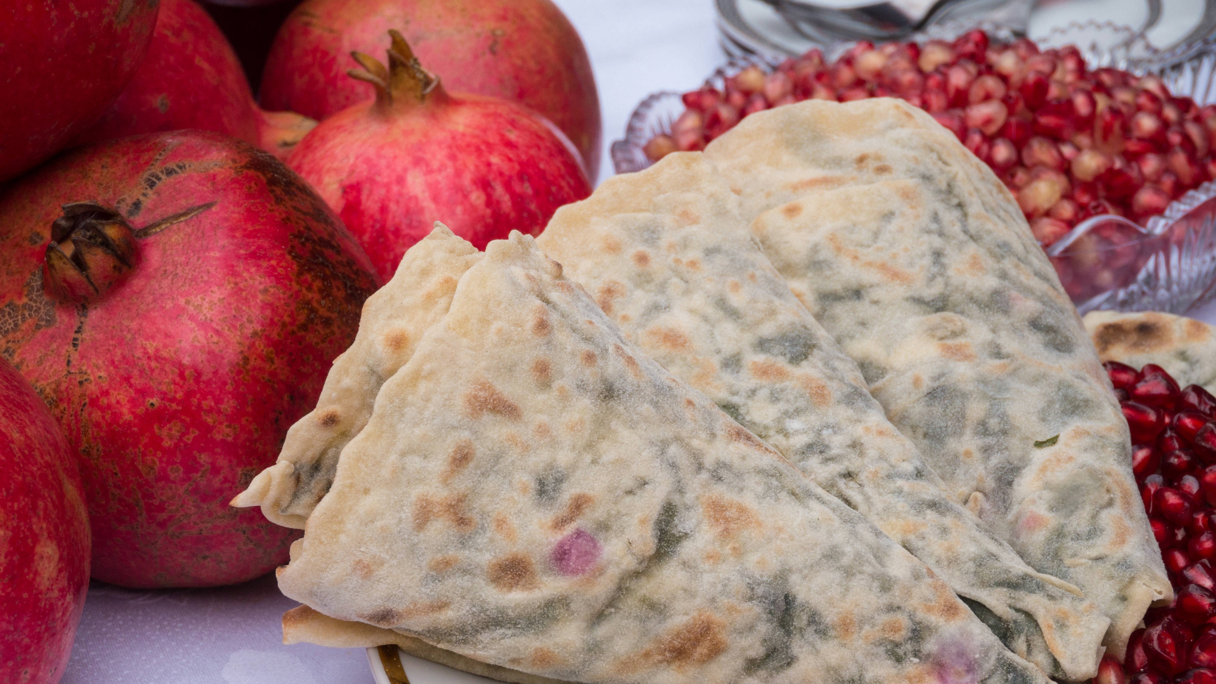 Qutab (pancakes) with nar (pomegranate), served at the annual Nar Festival in Göychay, Azerbaijan
