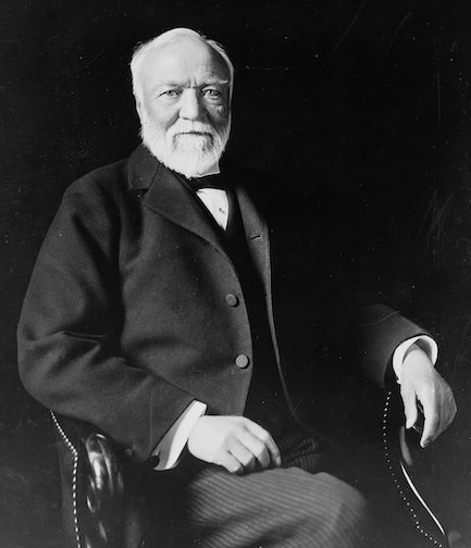 Andrew Carnegie, three-quarter length portrait, seated, facing slightly left.