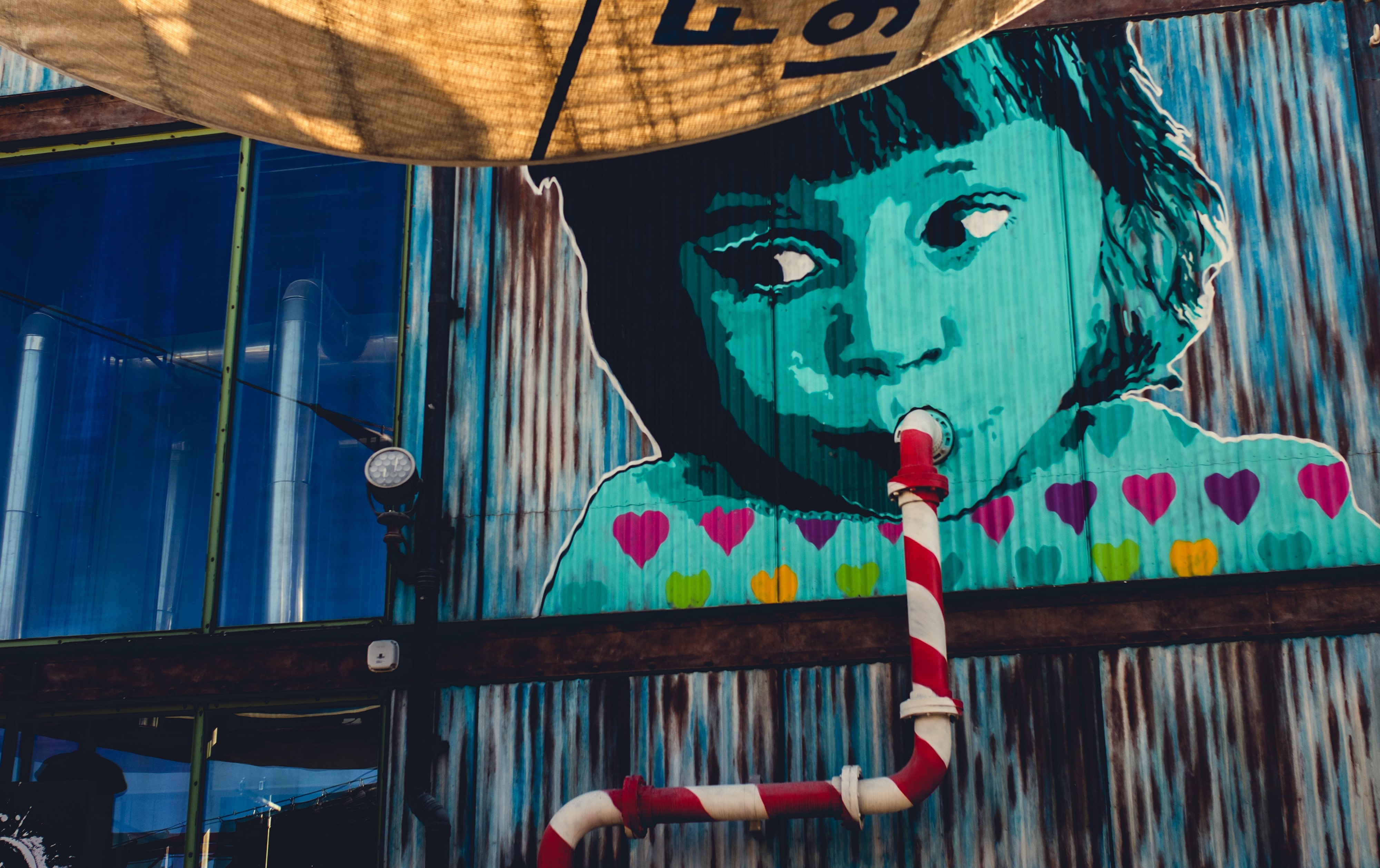 Graffiti of child sipping on pipe