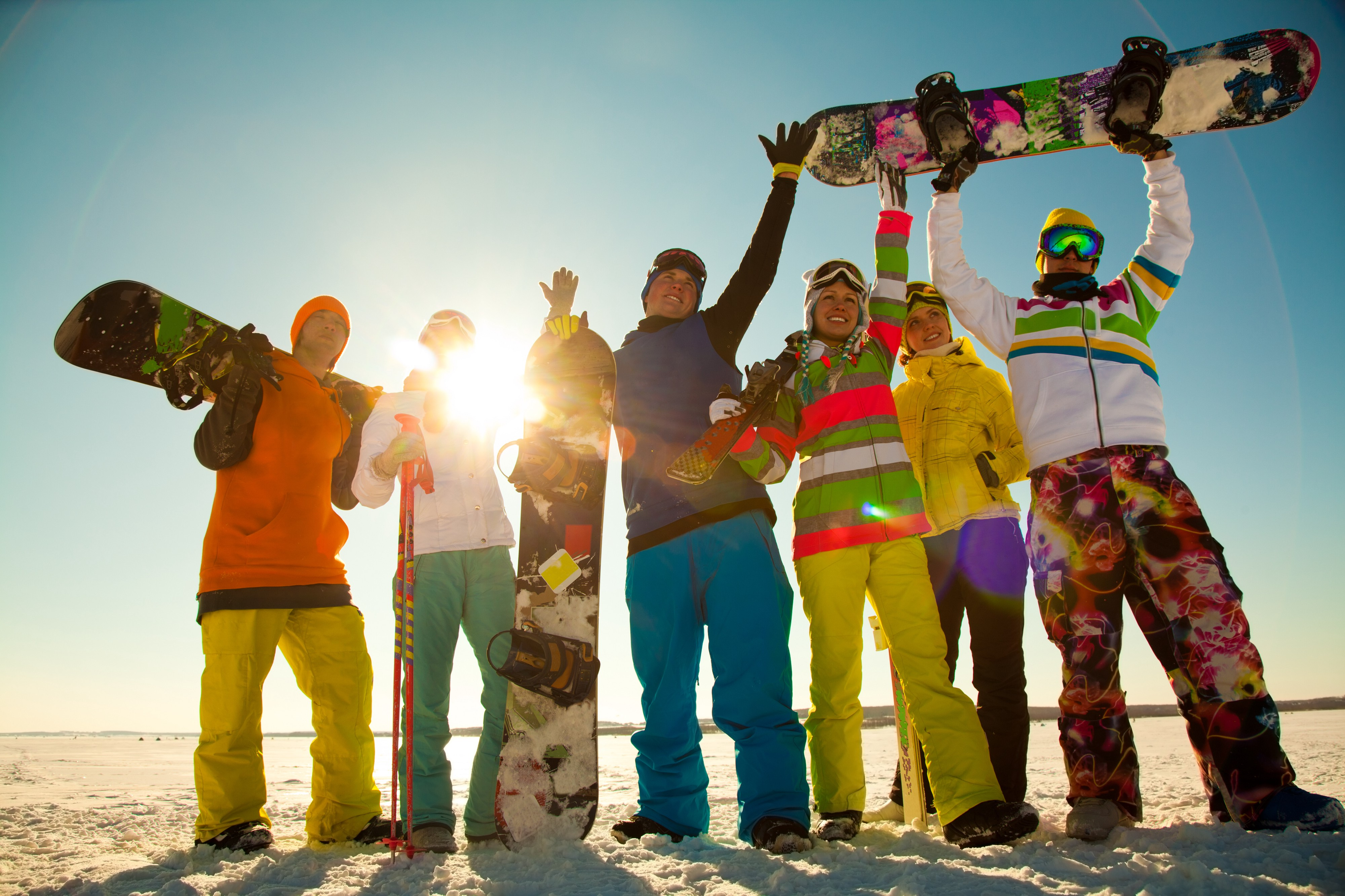 Group of snowboarding friends