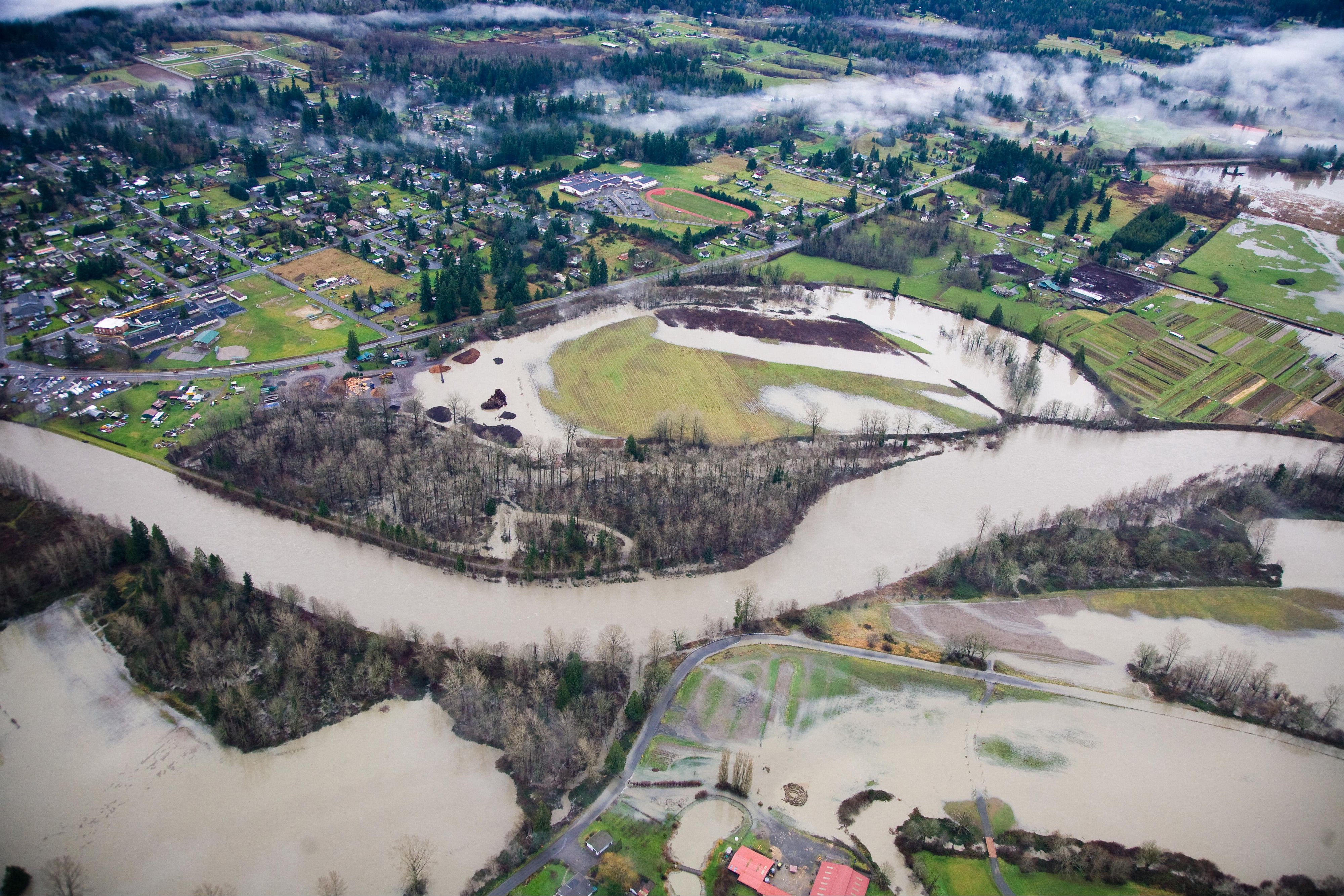 Aerial photo of the Fall City Floodplain Restoration Project, showing the Snoqualmie River and farmland. Photo credit: King County Water and Land Use Division.