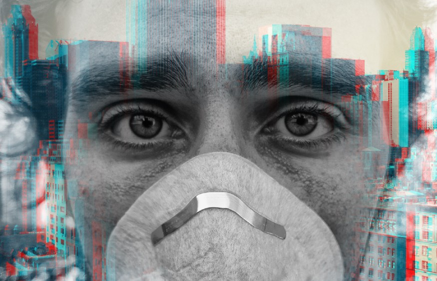 Double exposure portrait of a young man wearing a face mask and the New York City skyline.